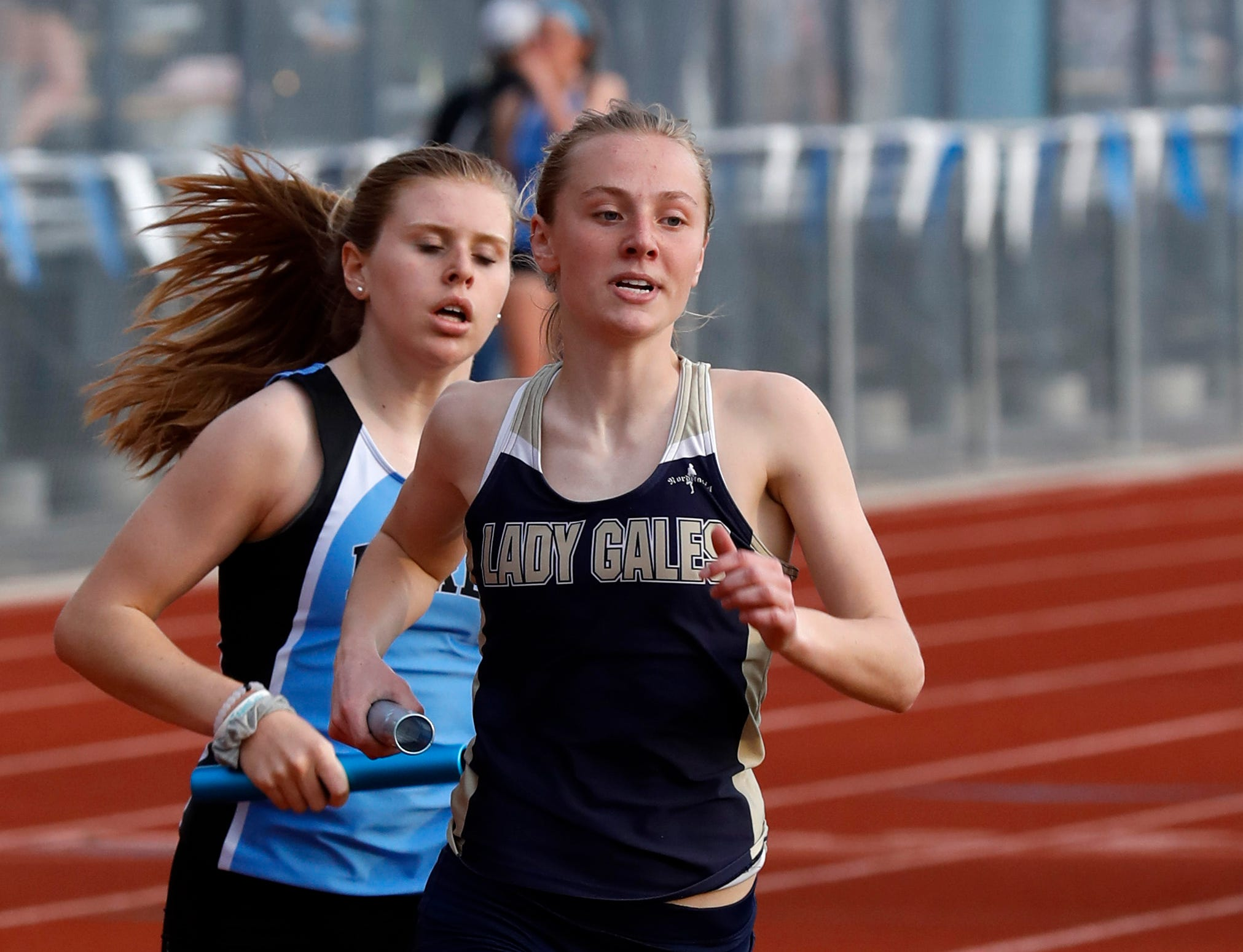 Lancaster's Elise Johnson runs in the 3200-meter relay Thursday night, April 18, 2019, during the Fulton Relays at Lancaster High School in Lancaster.