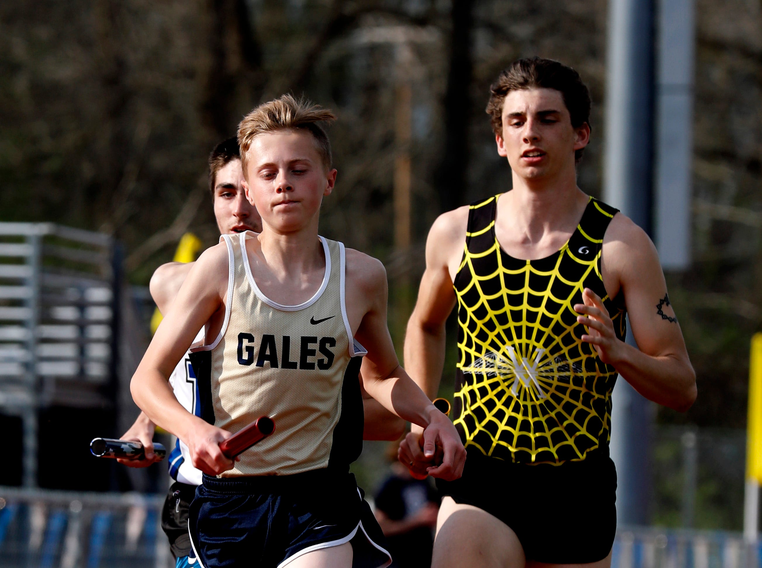 Lancaster's Nathan Craft runs in the 6400-meter relay Thursday night, April 18, 2019, during the Fulton Relays at Lancaster High School in Lancaster.
