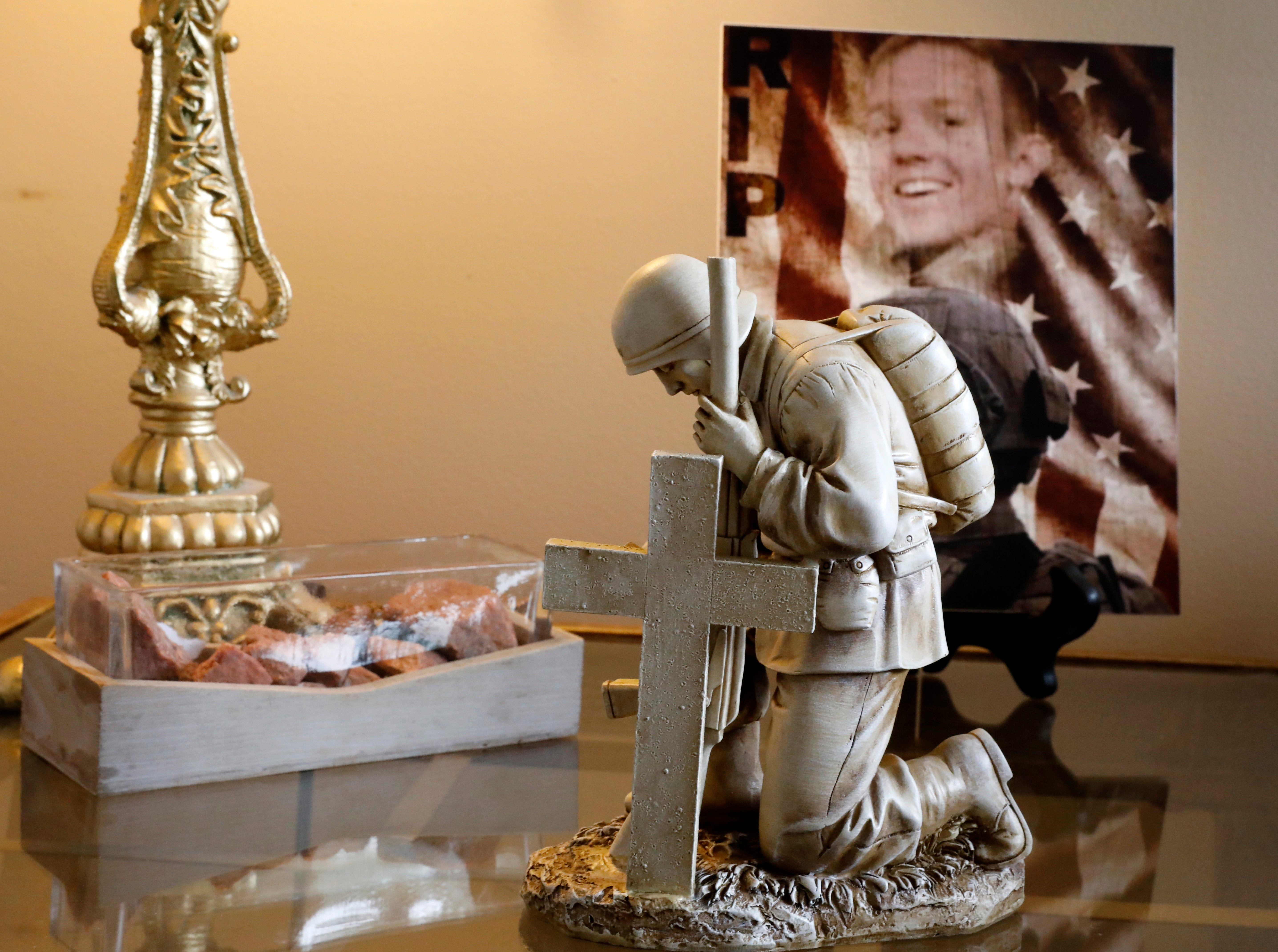 A statue of a soldier sits on an end table at Teri Mecionis house in Lancaster. Behind the statue is a photograph of Mecionis's son Army Sgt. Joseph Collette and rocks from Colorado were he was based.Collette was killed in Afghanistan in March.