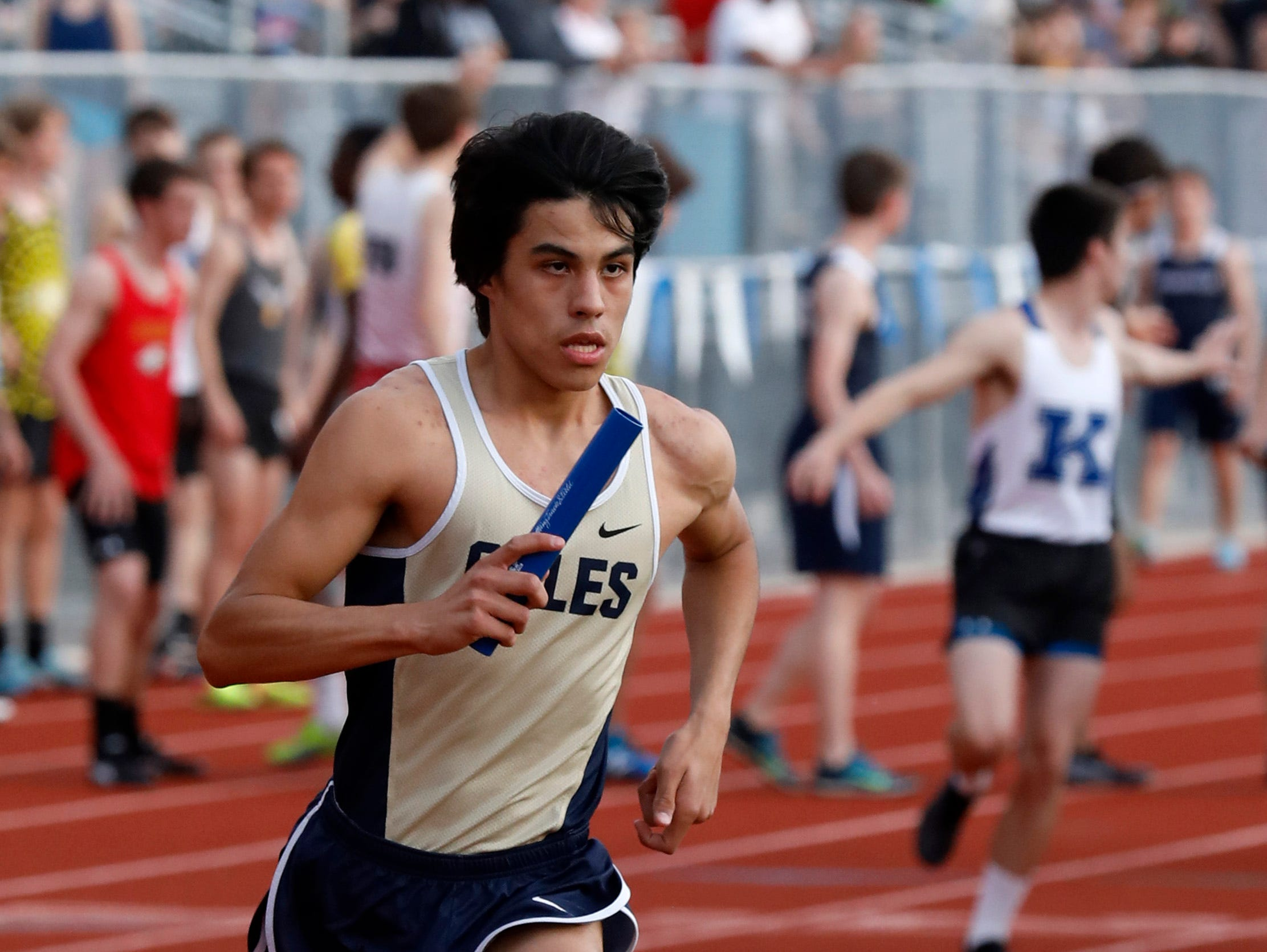 Lancaster's Ambronsio Suarez runs in the 3200-meter relay Thursday night, April 18, 2019, during the Fulton Relays at Lancaster High School in Lancaster.
