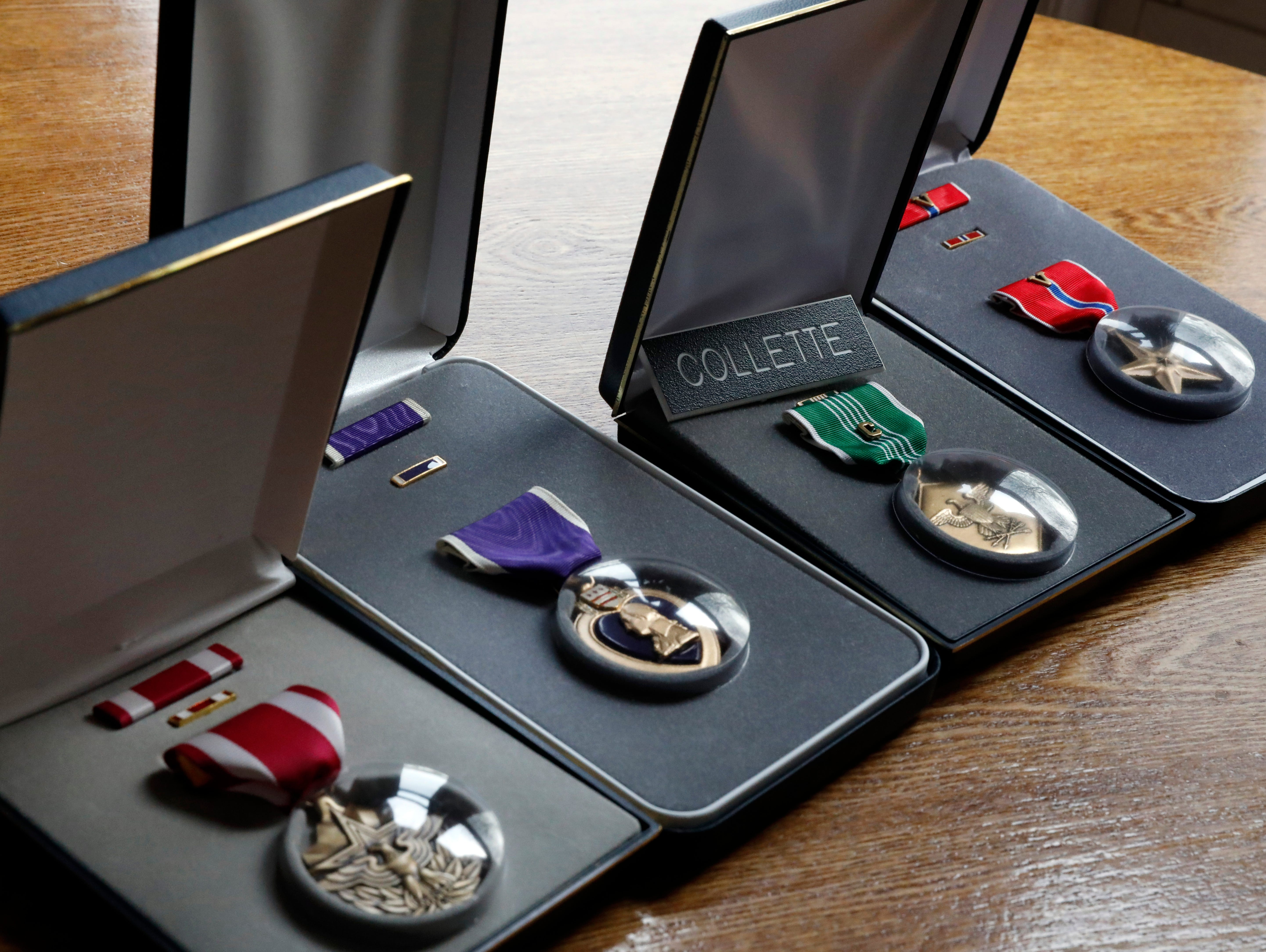 Sgt. Joseph Collette's medals, including a Meritorious Service Medal, a Purple Heart, a combat medal and a Bronze Star with a V device sit on his mother Teri Mecionis's kitchen table in Lancaster.