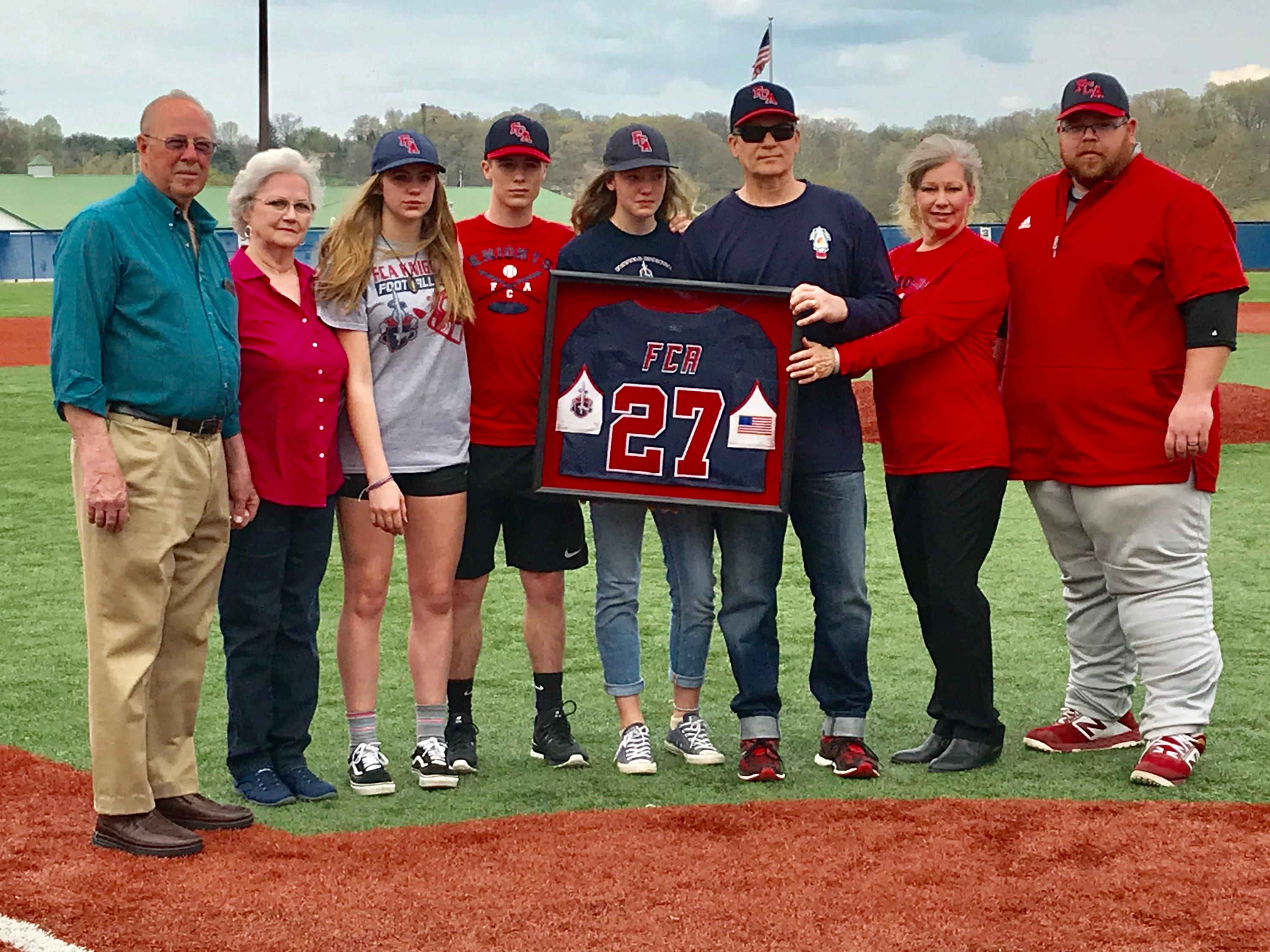 Fairfield Christian Academy graduate Jaakko Naayers, who passed away in January at the age of 21, had his baseball jersey retired Thursday. Receiving his jersey were members of his family, from left to right: Grandparents, Jim and Barb Schmelzer, sister, Janaya, brother, Asa, sister, Natalie, parents, Jeff and Charleen and FCA baseball coach Josh Baker.
