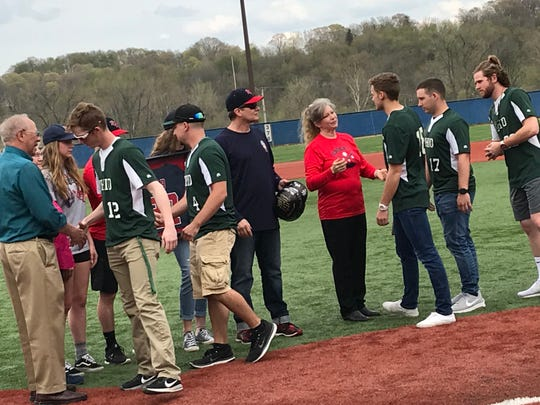 Members of the Ohio University Lancaster baseball team presented the Jaakko Naayers' family with a signed helmet during Thursday's ceremony.