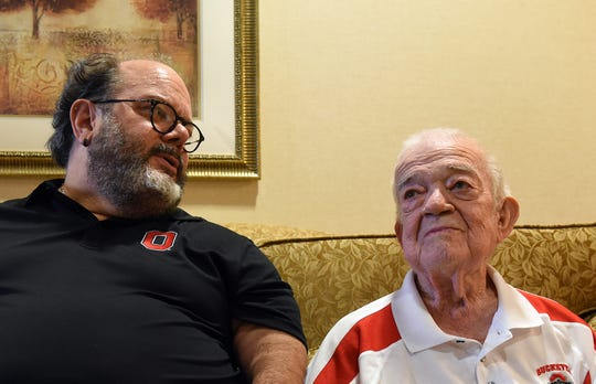 Frank Test sits with his father Lester Yager in a lobby of Heartland of Marion, where Yager lives. Test found his biological father after years of searching and help from a home DNA test kit connecting him with other relatives.