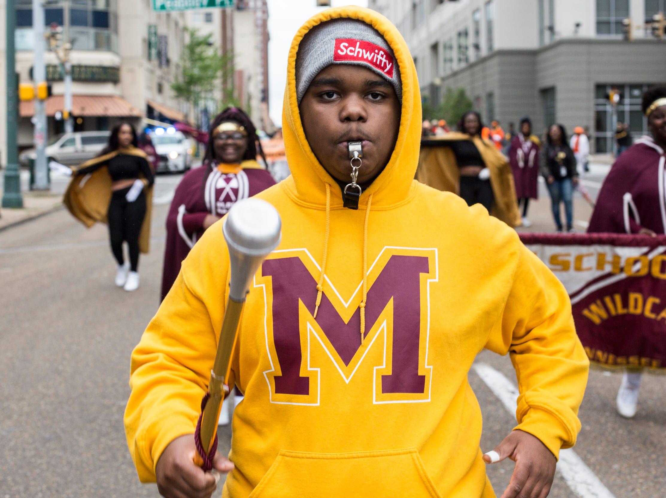 A band member marches during the Africa in April International Diversity Parade on Friday, April 19, 2019. The 33rd annual Africa in April Cultural Awareness Festival runs through April 21 at Robert Church Park.