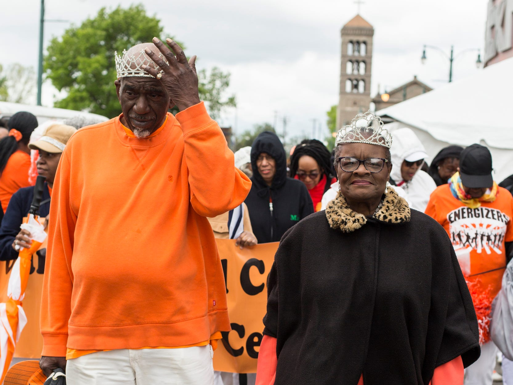 Preston Hurt, left, and W. Estelle Taylor, right, march as king and queen of the Orange Mound Senior Center during the Africa in April International Diversity Parade on Friday April 19, 2019. The 33rd annual Africa in April Cultural Awareness Festival runs through April 21 at Robert Church Park.