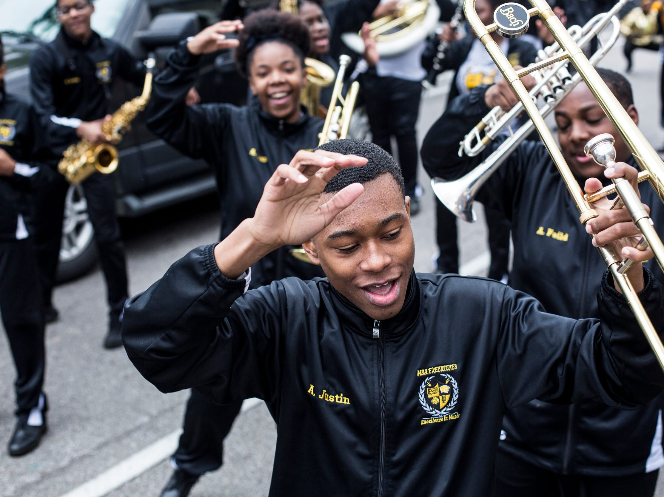 Justin Askew dances along with the Memphis Business Academy marching band before the start of the Africa in April International Diversity Parade on Friday, April 19, 2019. The 33rd annual Africa in April Cultural Awareness Festival runs through April 21 at Robert Church Park.