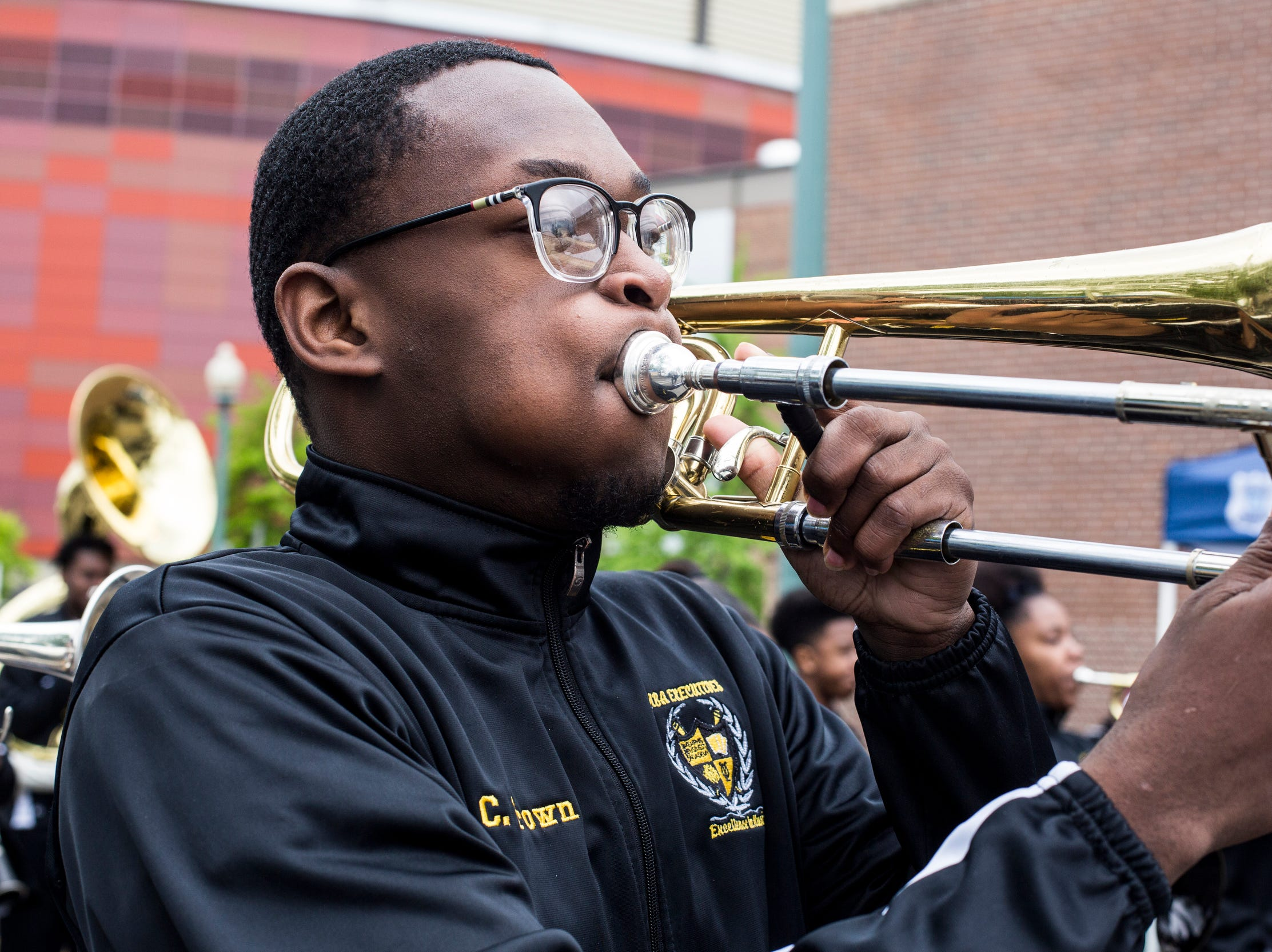 Christian Brown plays the trombone with the Memphis Business Academy during the Africa in April International Diversity Parade on Friday, April 19, 2019. The 33rd annual Africa in April Cultural Awareness Festival runs through April 21 at Robert Church Park.