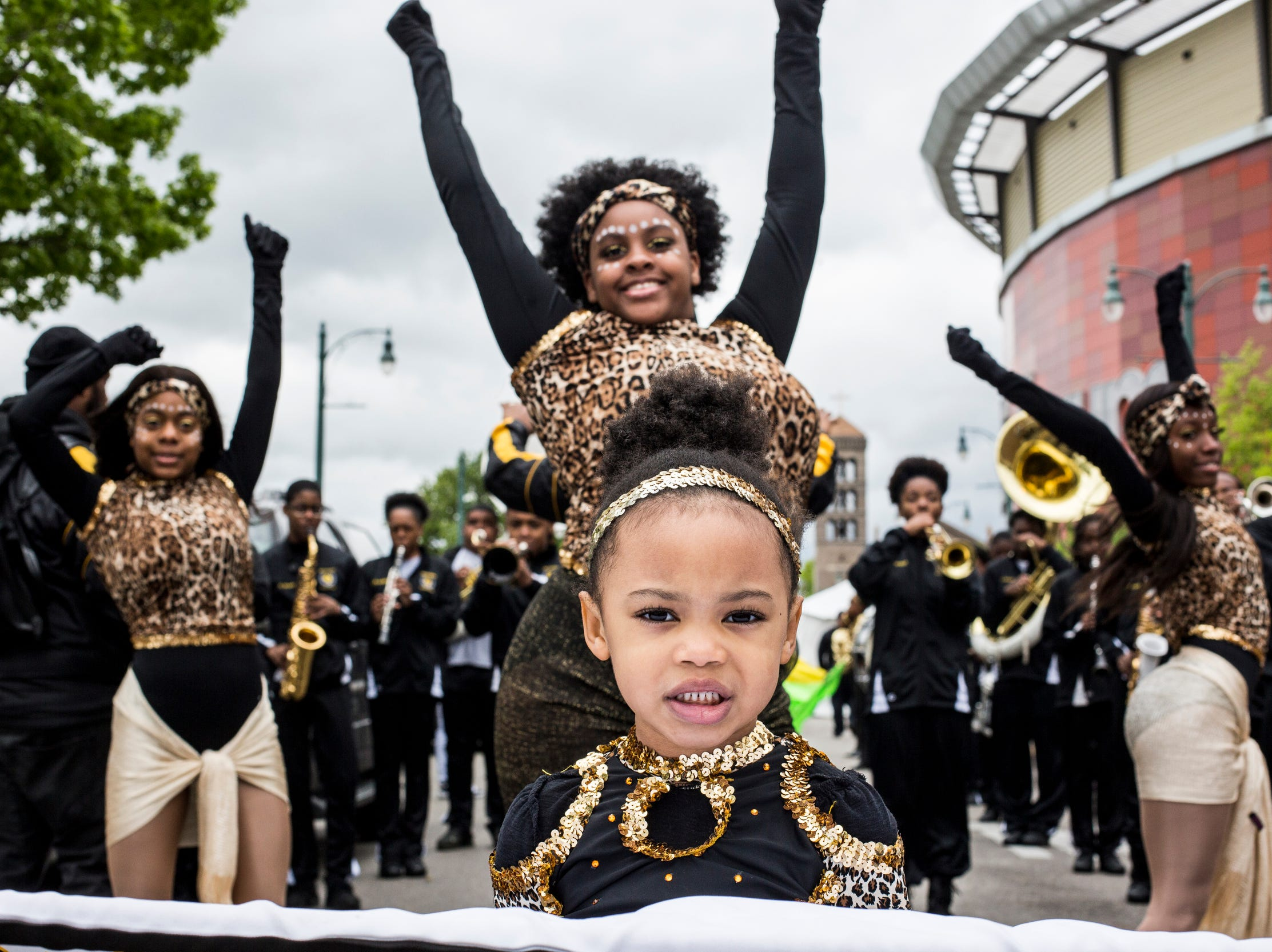 Sanaya Pearson, 4, lines up with the Memphis Business Academy marching band before the start of the Africa in April International Diversity Parade on Friday, April 19, 2019. The 33rd annual Africa in April Cultural Awareness Festival runs through April 21 at Robert Church Park.