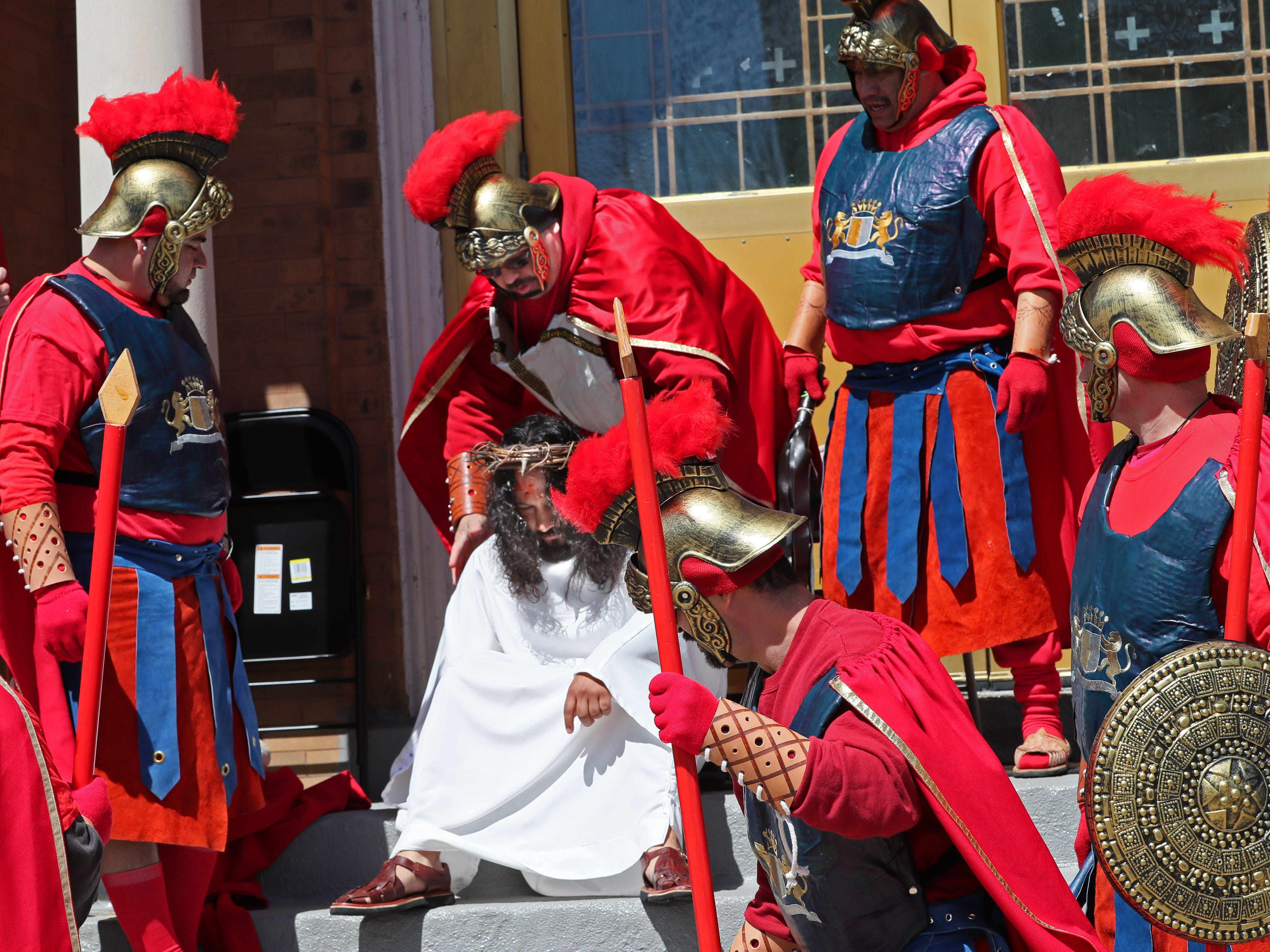 Roman soldiers place a crown of thornes on the head of Jesus during a re-enactment of the Passion of Jesus Christ on Good Friday. Jesus is played by Pedro Rangel of Milwaukee.