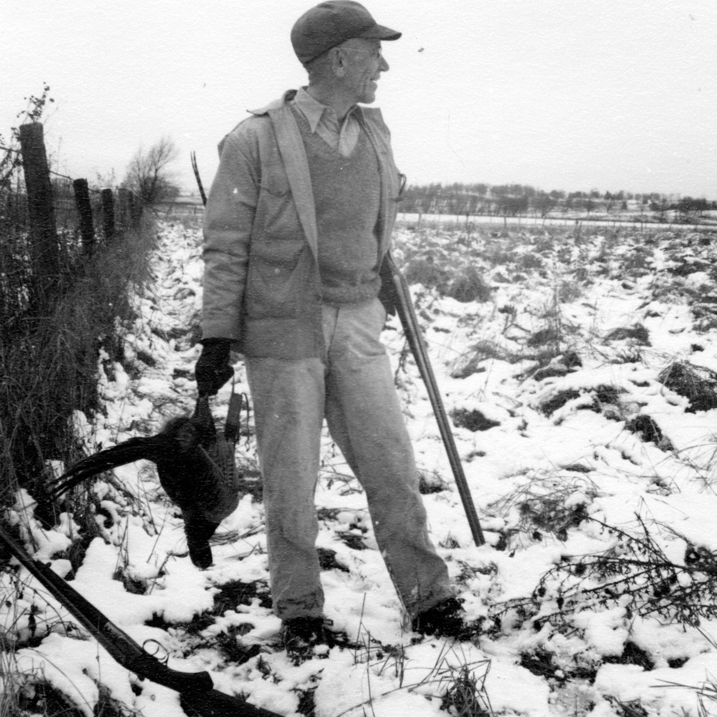 Aldo Leopold holds a ring-necked pheasant during...