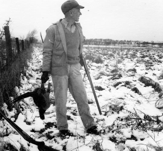 Aldo Leopold holds a ring-necked pheasant during a Nov. 1943 hunt at Riley Preserve in Riley, Wisconsin.