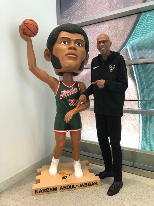 Kareem Abdul-Jabbar poses with his over-sized bobblehead at Fiserv Forum on April 14.