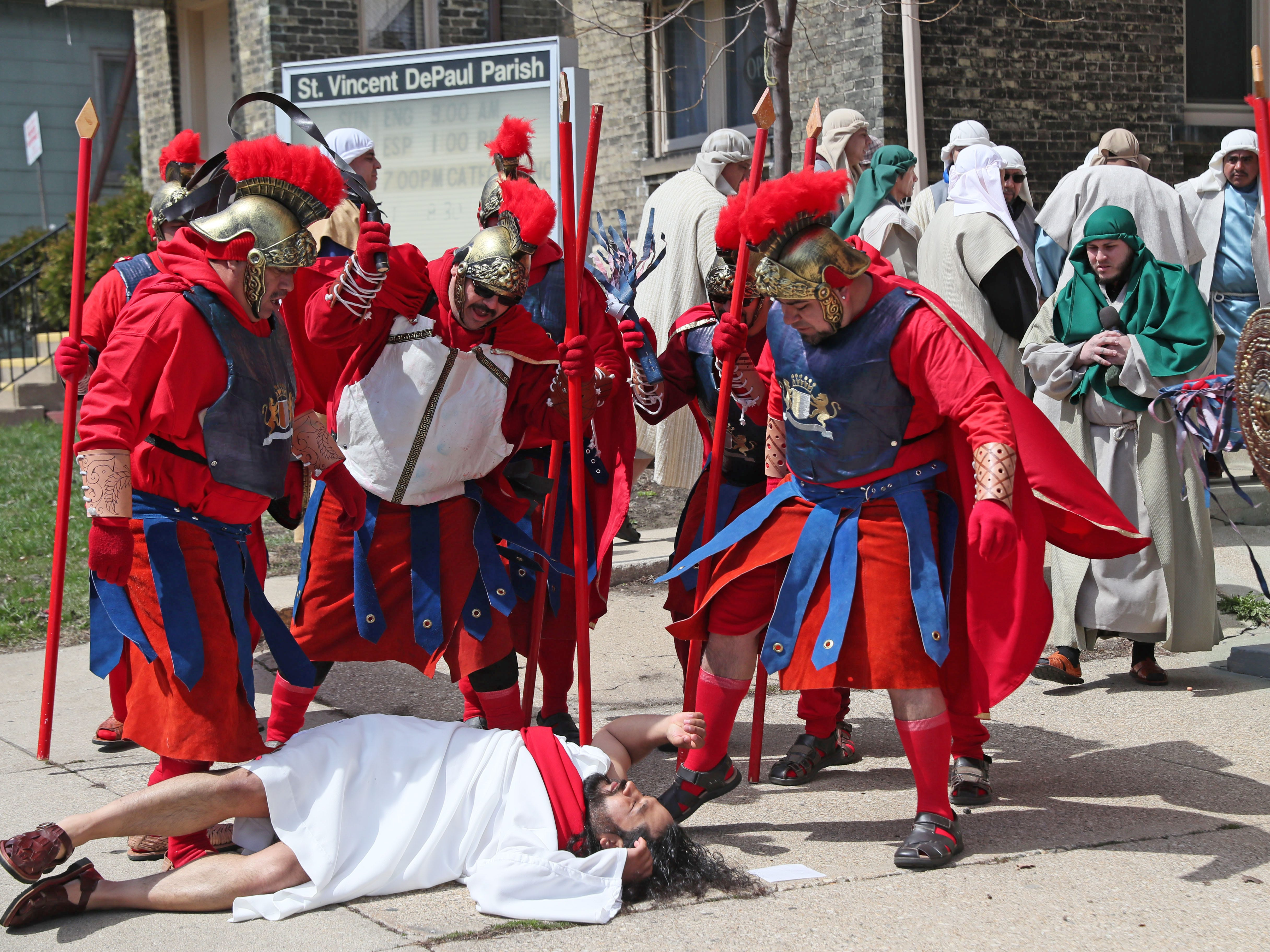 Jesus is beaten and kicked after his arrest by Roman soldiers.
