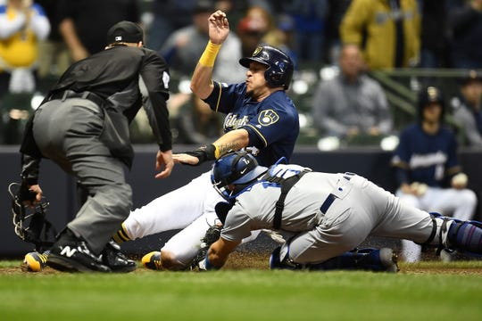 Hernan Perez is a dead duck at home as Brewers third-base coach Ed Sedar inexplicably waved him home on Lorenzo Cain's two-out single to left with Christian Yelich on deck and Milwaukee down three runs in the eighth inning.