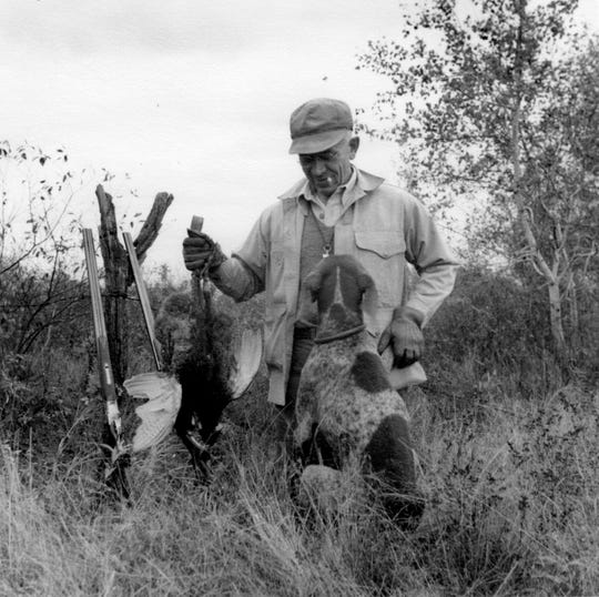 Aldo Leopold was photographed with his dog Gus, a ring-necked pheasant and two side-by-side shotguns after an Oct. 1943 hunt at the Leopold Shack near Baraboo, Wisconsin.