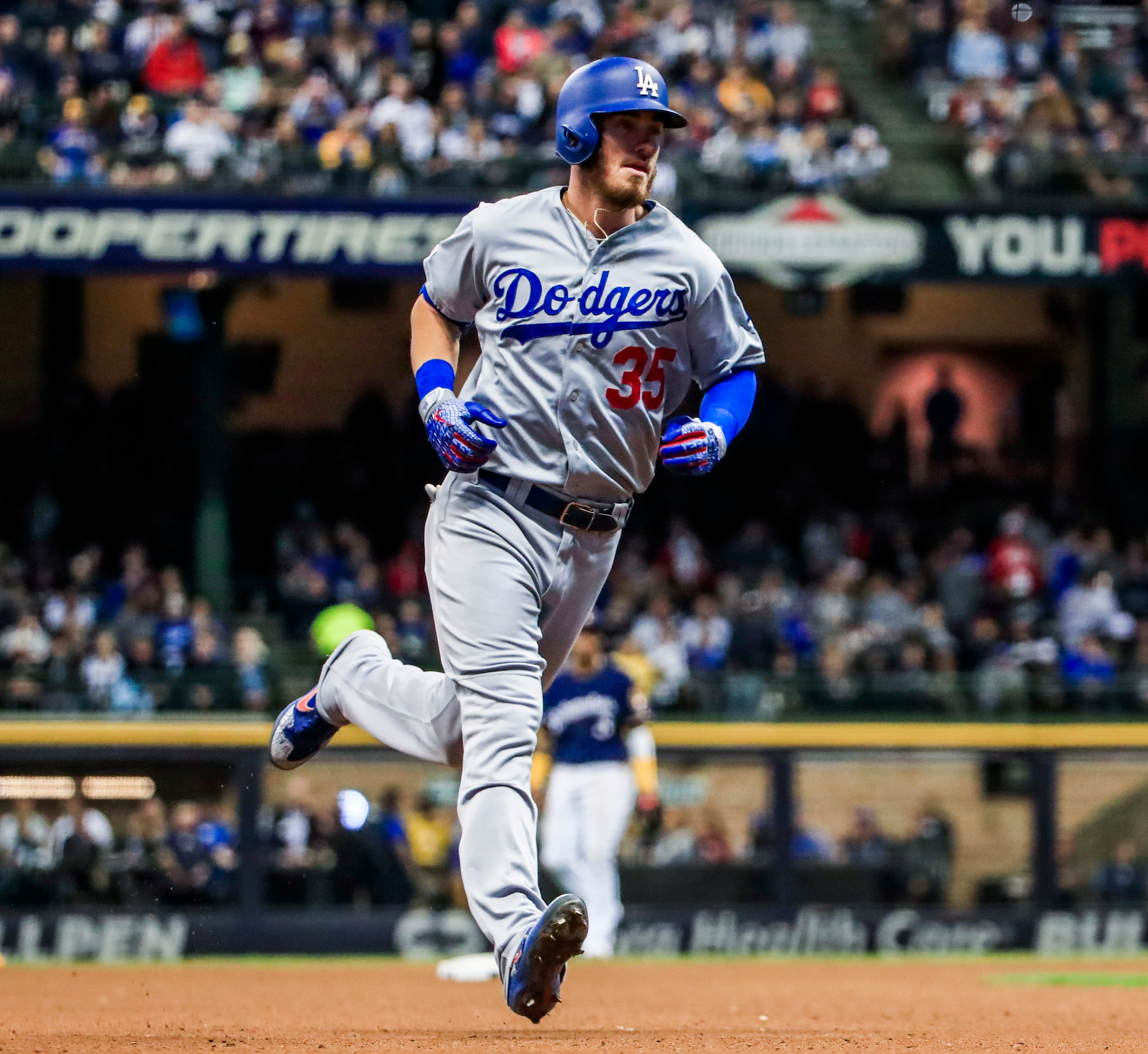 Dodgers right fielder Cody Bellinger rounds the bases after hitting a homer off Matt Albers in the sixth inning.