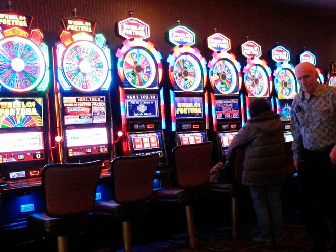 Gamblers try their luck at slot machines.