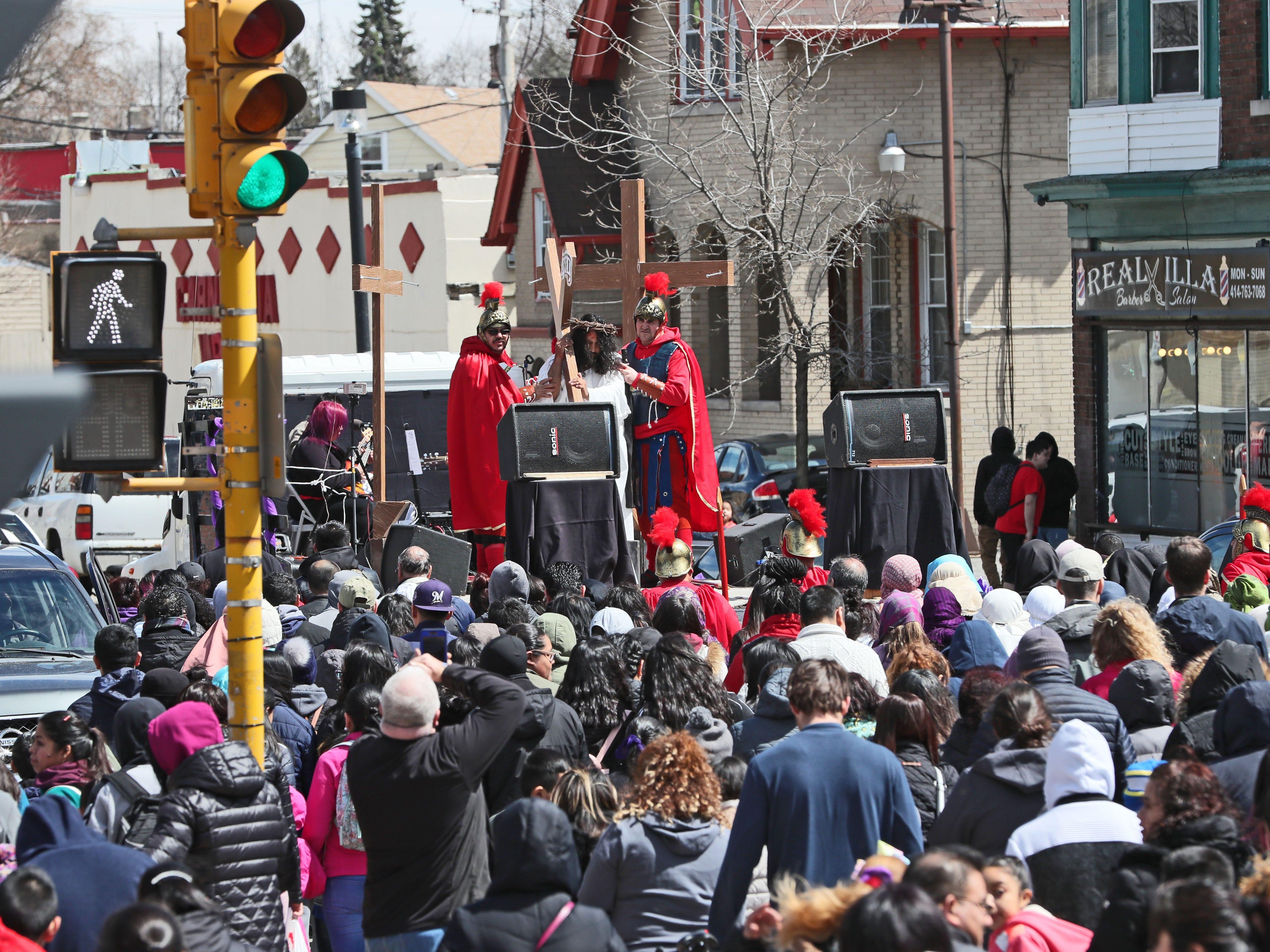 The procession leaves St. Vincent de Paul.