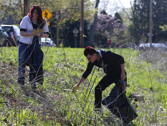 Volunteers help clean up along the Menomonee River in Wauwatosa in 2017. Milwaukee Riverkeeper's 24th annual Spring River Cleanup is Saturday.
