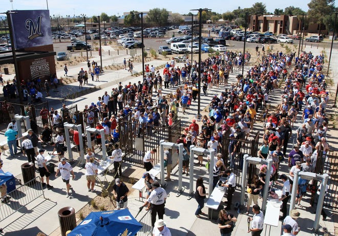 Fans enter revamped American Family Fields of Phoenix to watch a Milwaukee Brewers spring training game.