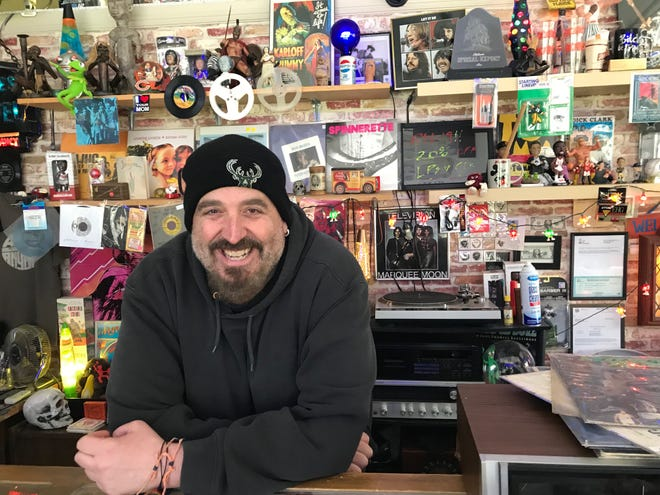 Chris Kruse runs Off the Beaten Path record store in Bay View. Patrons get a discount based on the margin of victory in Bucks wins the day before.