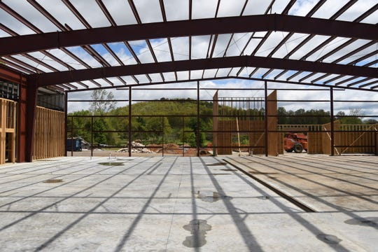 Dryer Mountain is seen in the background through the steel framework of Christ Community Church's new worship center, which is currently under construction on Highway 201 N.