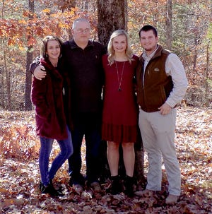 Chip Layne (second from left) has been named as the superintendent of the Norfork Public School District. Pictured with Layne are (from left) his wife, Ashley, daughter, Whitlee, and son, Taylor.