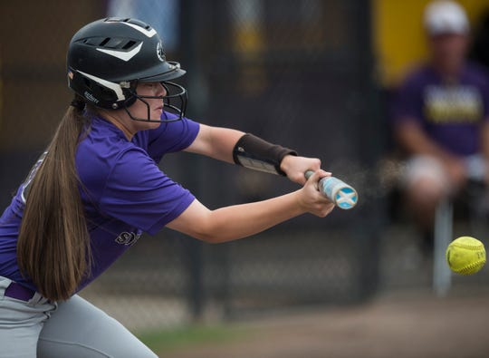 Prattville Christian's Sarah Williams (11) bunts the ball at Southside Middle School in Tallassee, Ala., on Thursday, April 18, 2019. Prattville Christian defeated Tallassee 12-10.