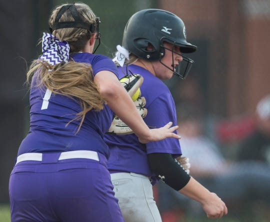 Tallassee's Jordan Walters (7) chases down Prattville Christian's Carolyn Carter (00) at Southside Middle School in Tallassee, Ala., on Thursday, April 18, 2019. Prattville Christian defeated Tallassee 12-10.