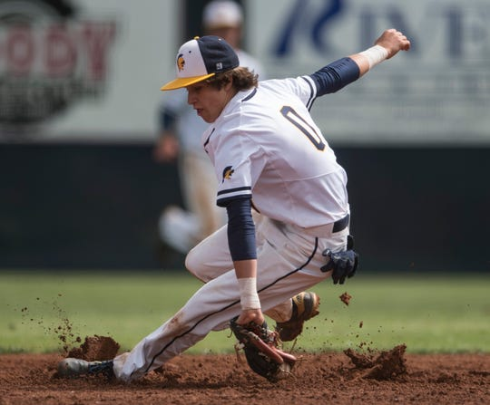 St. James' Zachary Russell (0) grabs a ground ball at St. James School in Montgomery, Ala., on Friday, April 19, 2019. St. James defeated Randolph County 7-0 in the first game of a doubleheader.