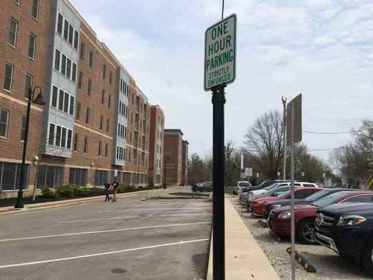Ball State University provides free, two-hour parking in a parking lot, right, behind Village Promenade.