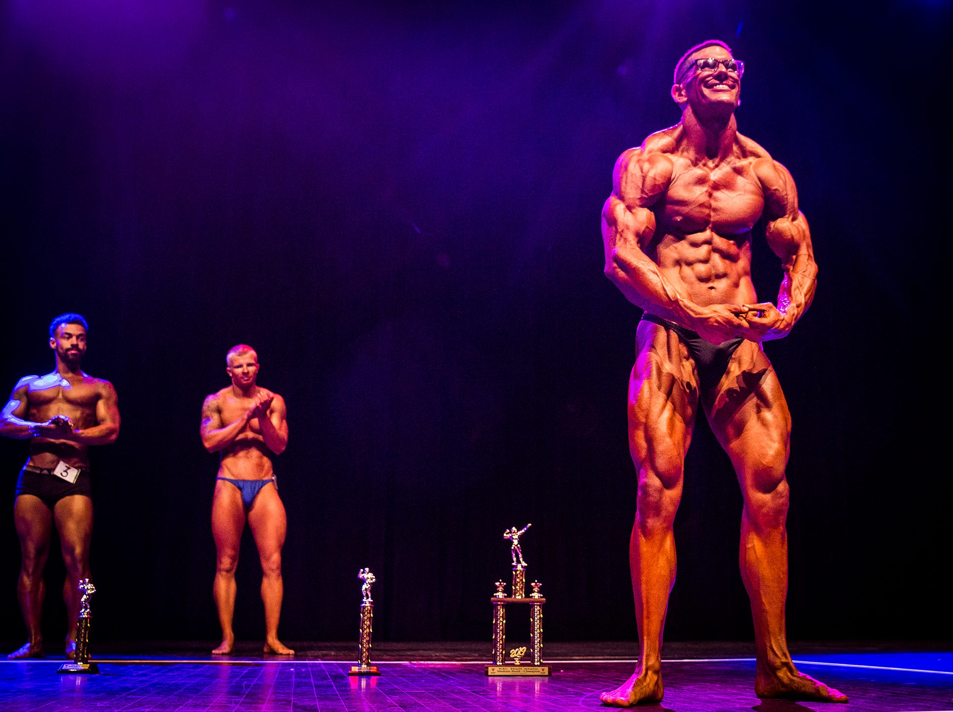 Medium class winner Mike Breitung faces off against tall class winner Jack Southard during the Mr. And Ms. Ball State bodybuilding competition at Emens Auditorium Thursday night.