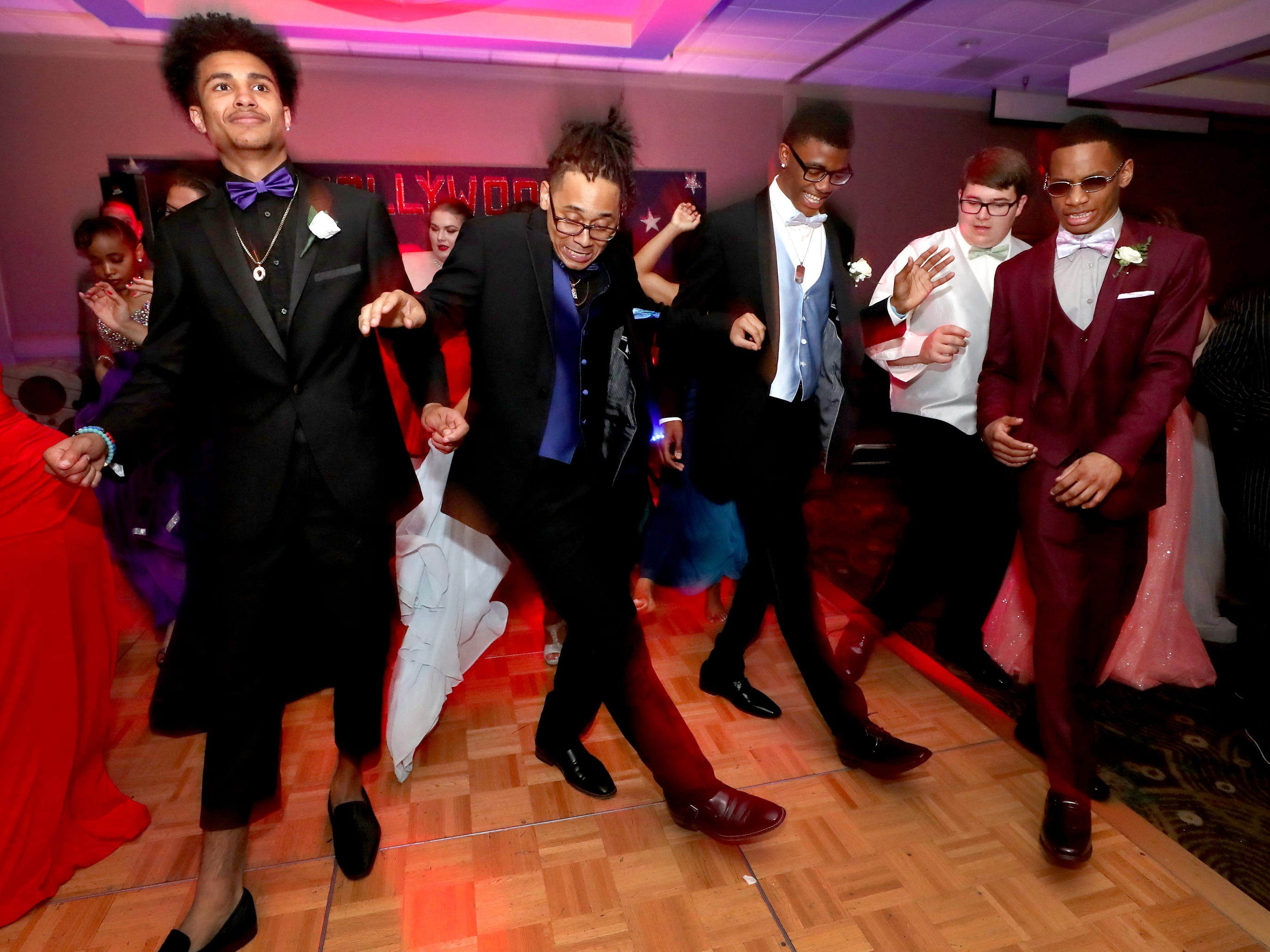 (L to R) Jayden Hernandez, Jamarion Buchanan, Dmarco Haynes, Nate Steinhurst and Aalijah Daniel all dance at Holloway's prom at the DoubleTree on Thursday April 18, 2019.