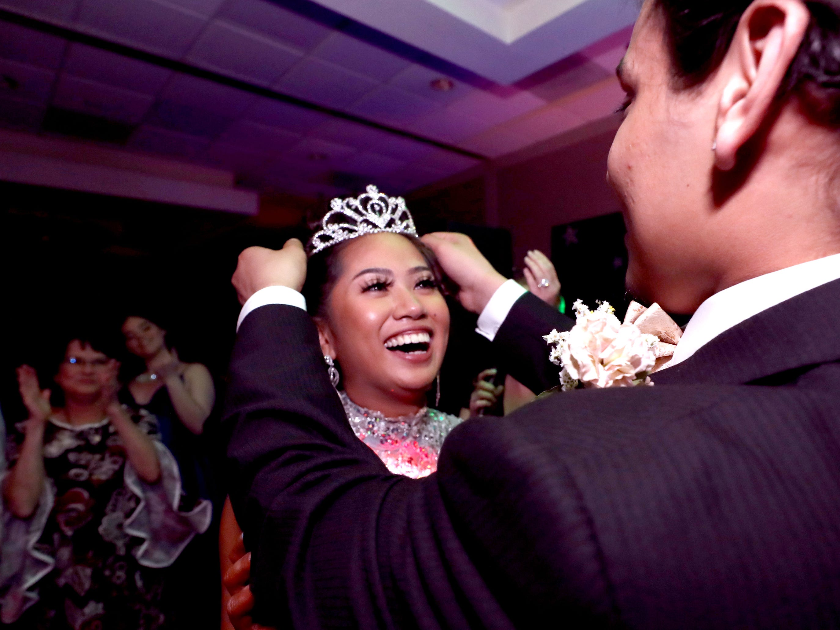 Prom King Diego Valencia crowns Anna Kounboribounsak Prom Queen at Holloway's prom at the DoubleTree on Thursday April 18, 2019.