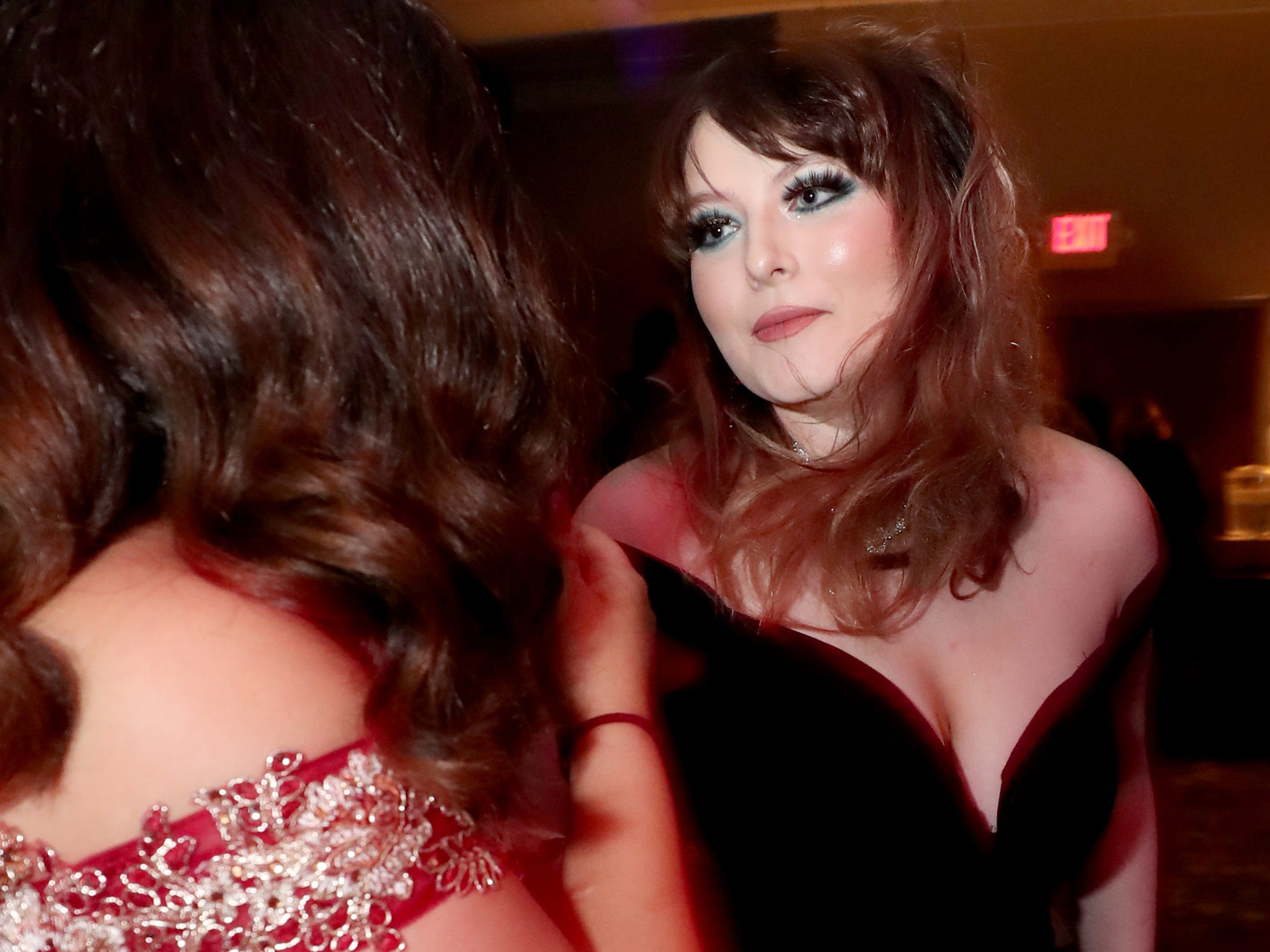 Elizabeth Perez, left and Mary Nation, right dance on the dance floor at Holloway's prom at the DoubleTree on Thursday April 18, 2019.