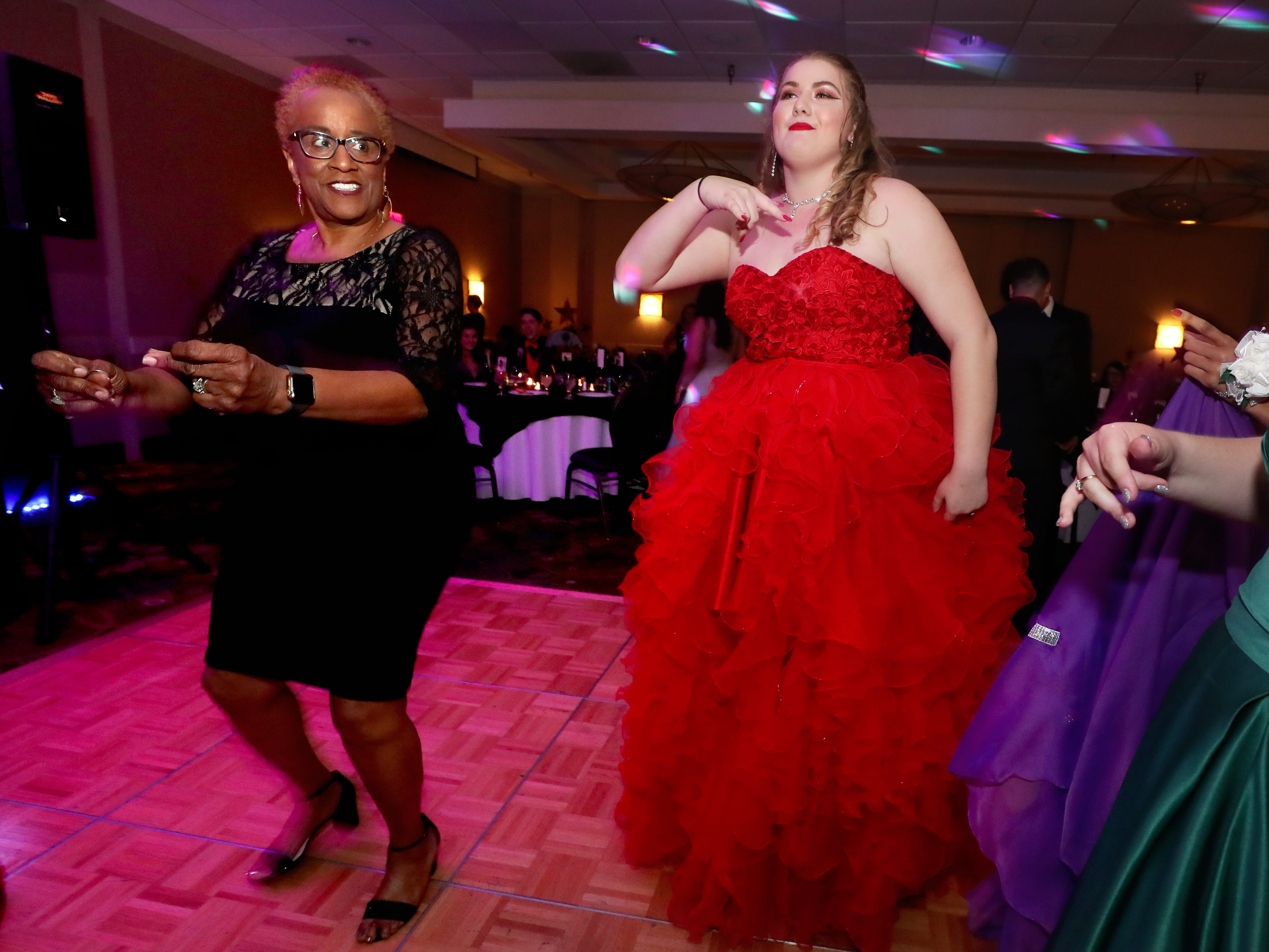 Holloway Principal Sumatra Drayton, left and Cortney Springer, right dance on the dance floor at Holloway's prom at the DoubleTree on Thursday April 18, 2019.