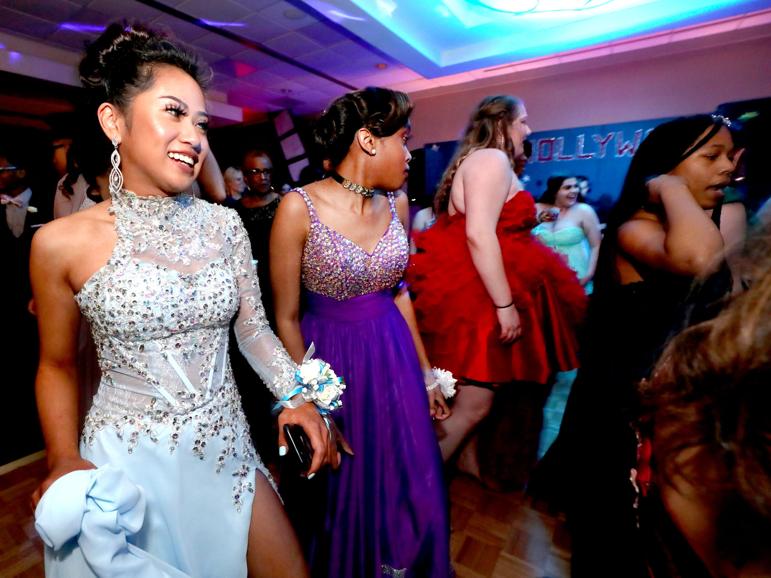 Anna Kounboribounsak dances on the dance floor at Holloway's prom at the DoubleTree on Thursday April 18, 2019.