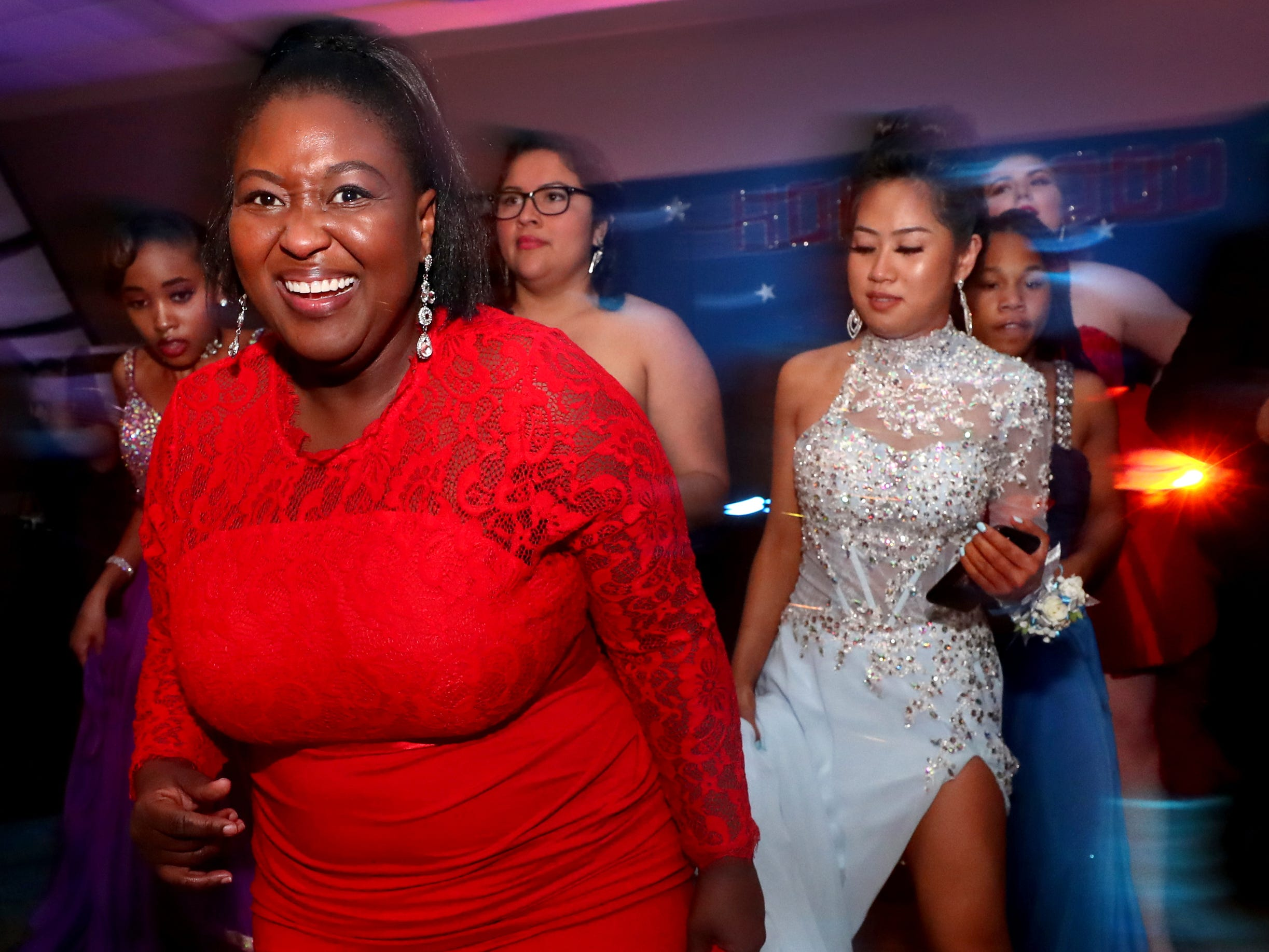 Sheneka Hernandez dances on the dance floor at Holloway's prom at the DoubleTree on Thursday April 18, 2019.