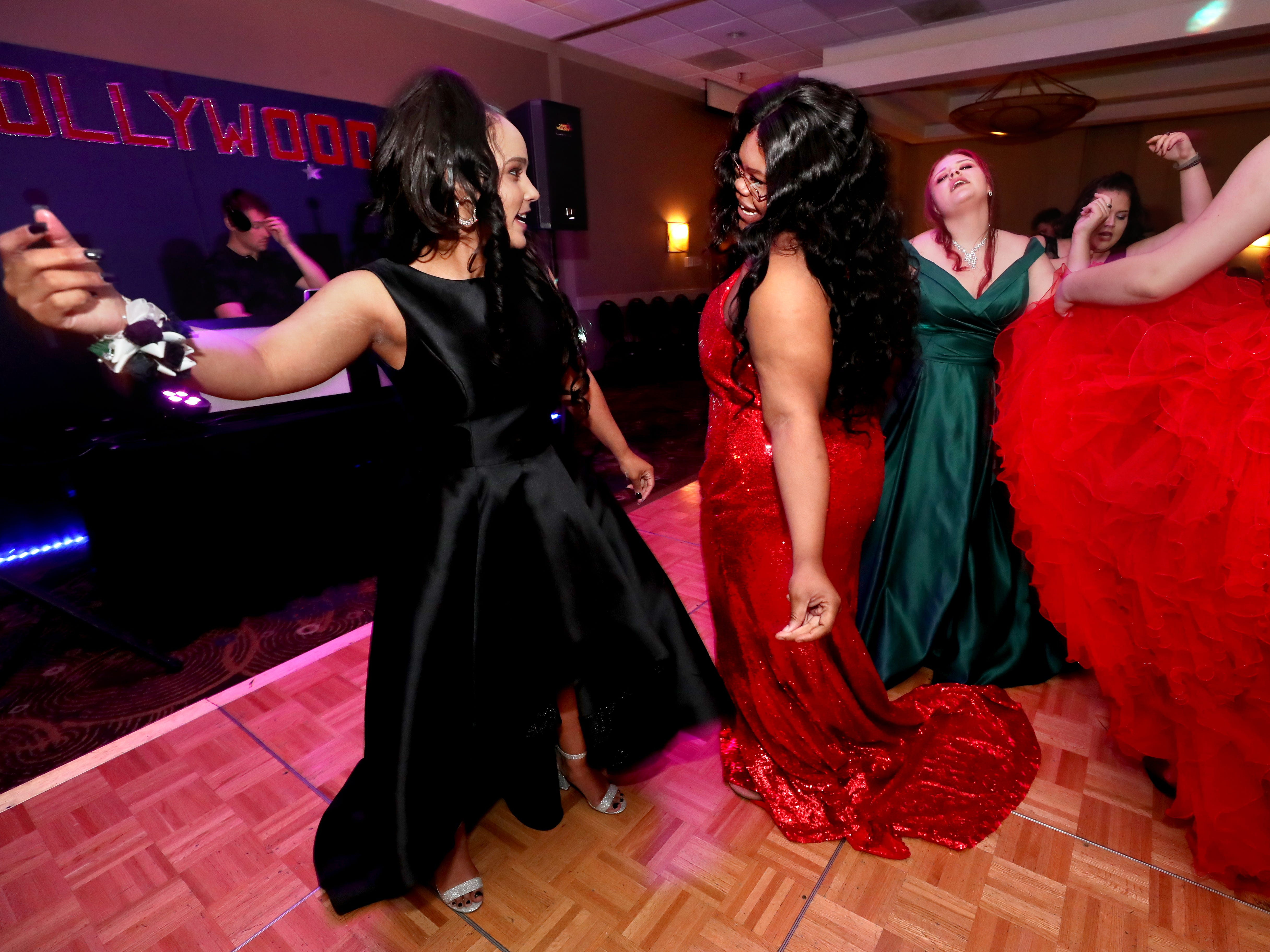 Miracle Knox, left and Jakeyia Alexander, right dance on the dance floor at Holloway's prom at the DoubleTree on Thursday April 18, 2019.