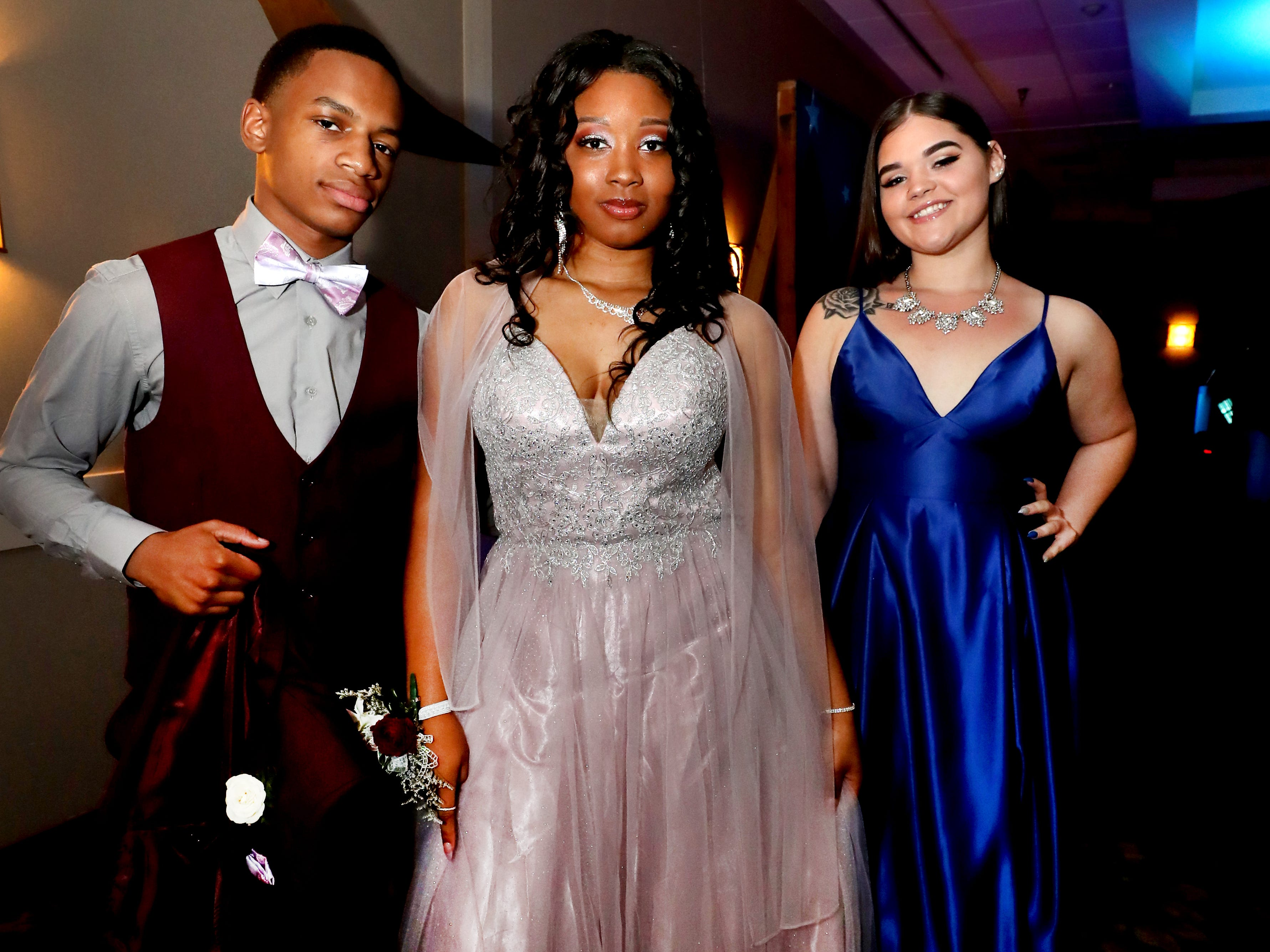 Aalijah Daniel, left, Antoinette Sherrell, center, and Alyssa Pitts, right at Holloway's prom at the DoubleTree on Thursday April 18, 2019.