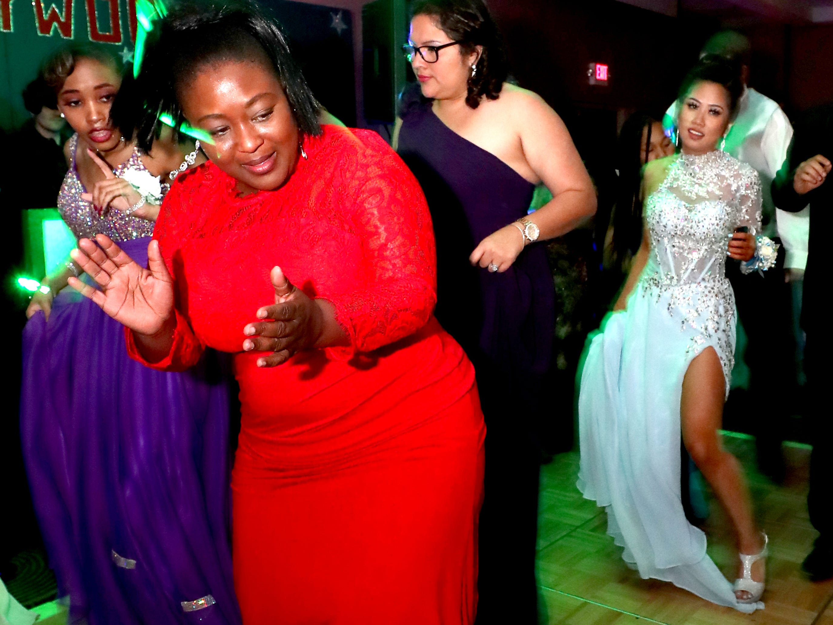Sheneka Hernandez dances on the dance floor at Holloway's prom at the DoubleTree on Thursday April 18, 2019..