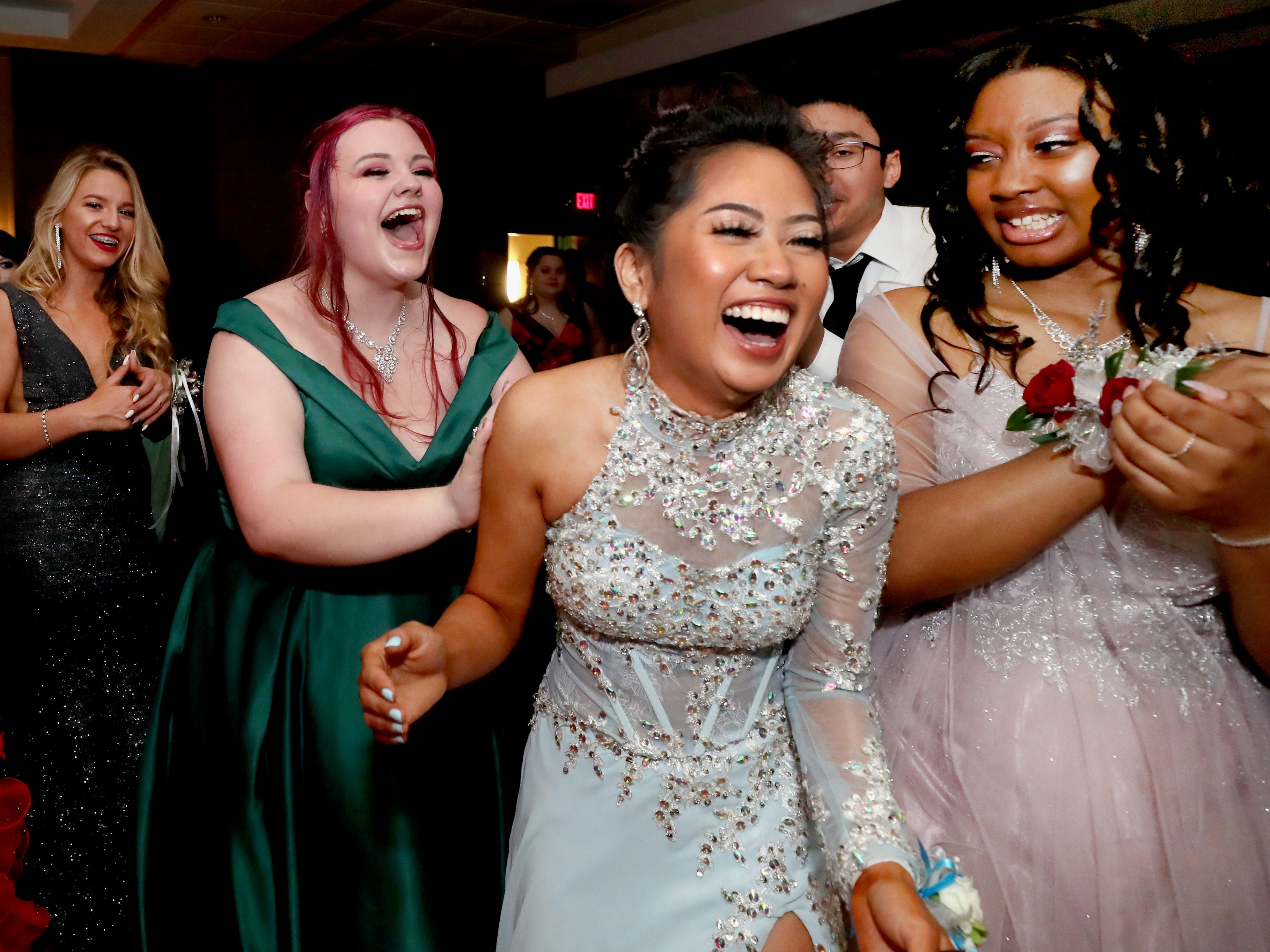 Anna Kounboribounsak reacts as she is named Holloway High's Prom Queen at Holloway's prom at the DoubleTree on Thursday April 18, 2019.