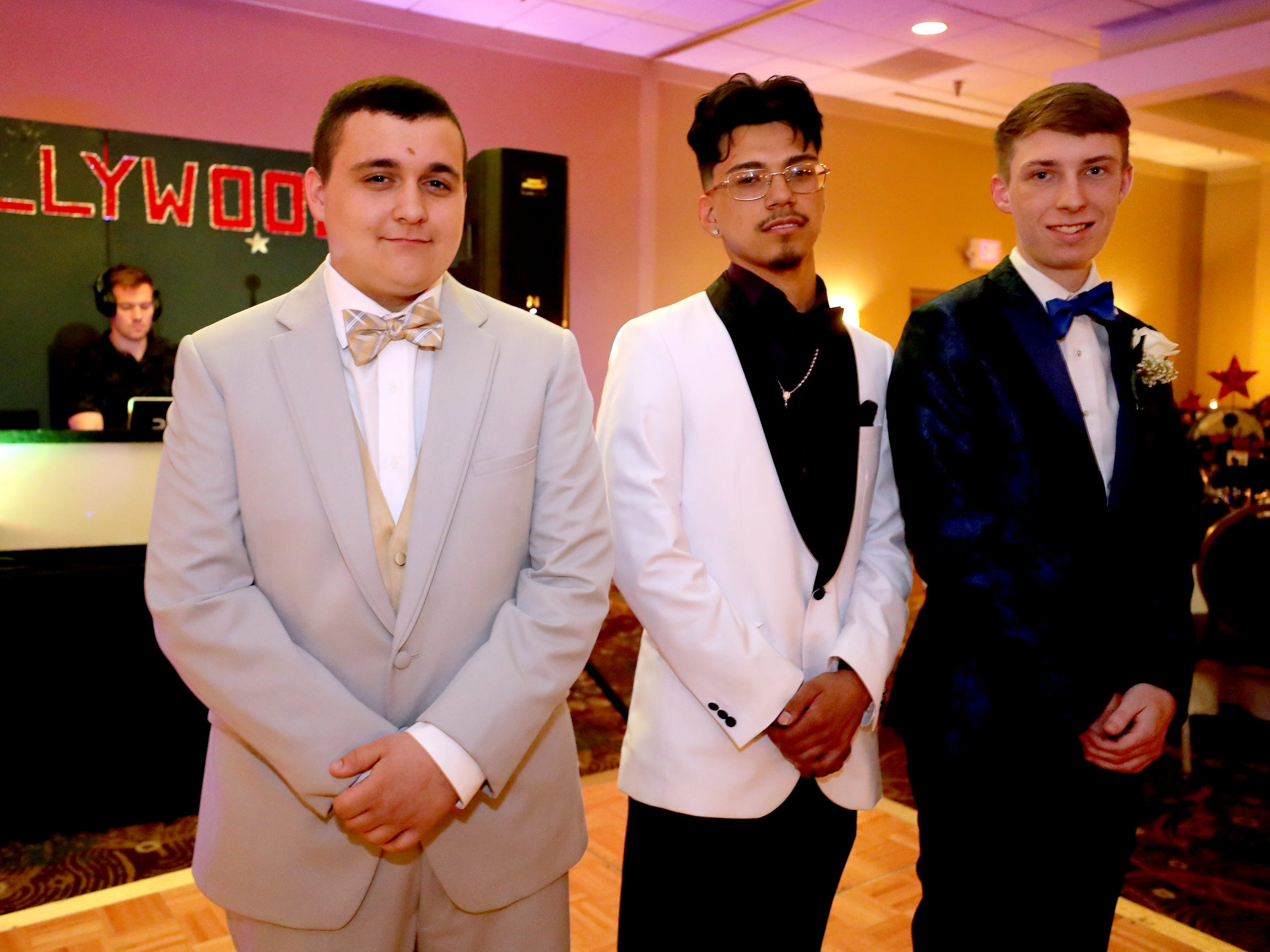 Jacob Smitty, left, Oscar Romero, center, and Tyler Hollis at Holloway's prom at the DoubleTree on Thursday April 18, 2019.