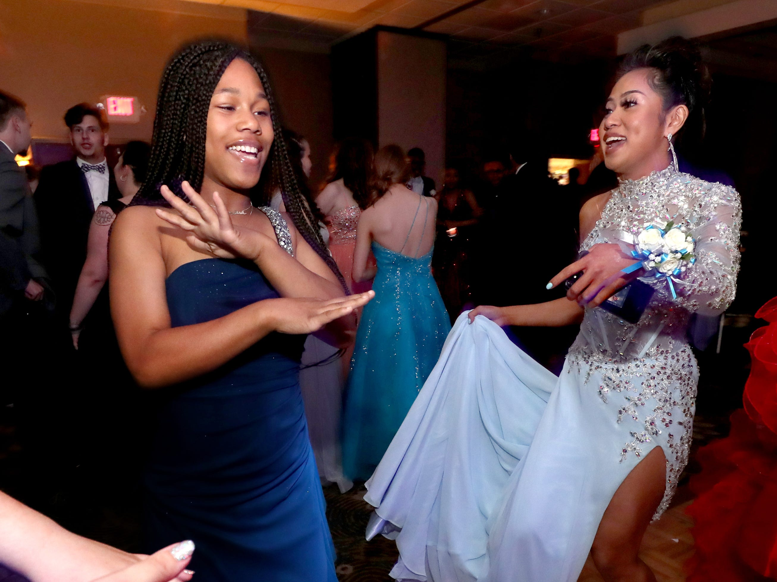 Yaqueenisha Murray, left and Anna Kounboribounsak, right dancing at Holloway's prom at the DoubleTree on Thursday April 18, 2019.