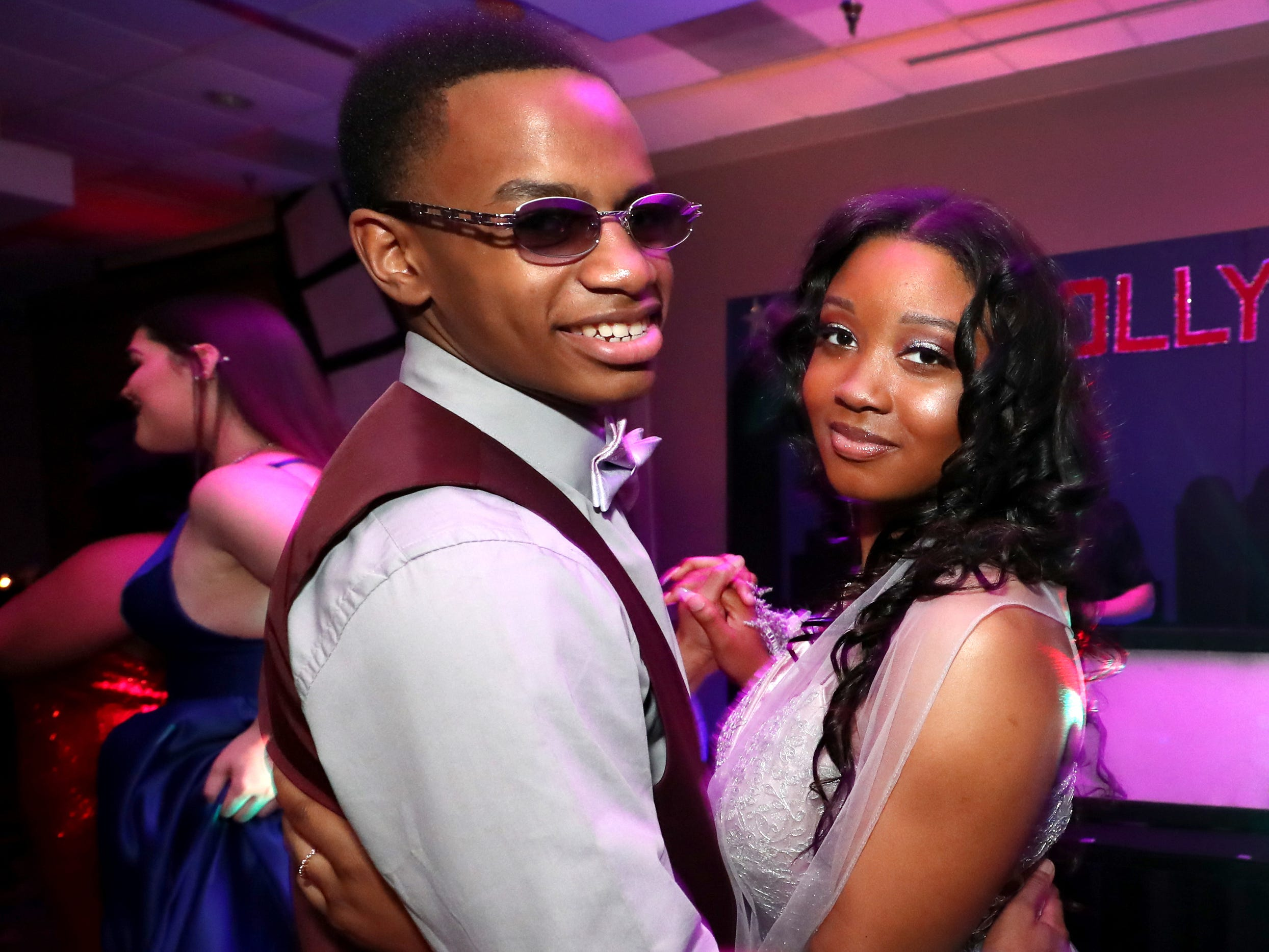 Aalijah Daniel, left, and Antoinette Sherrell, right dance on the dance floor during a slow dance during Holloway's prom at the DoubleTree on Thursday April 18, 2019.