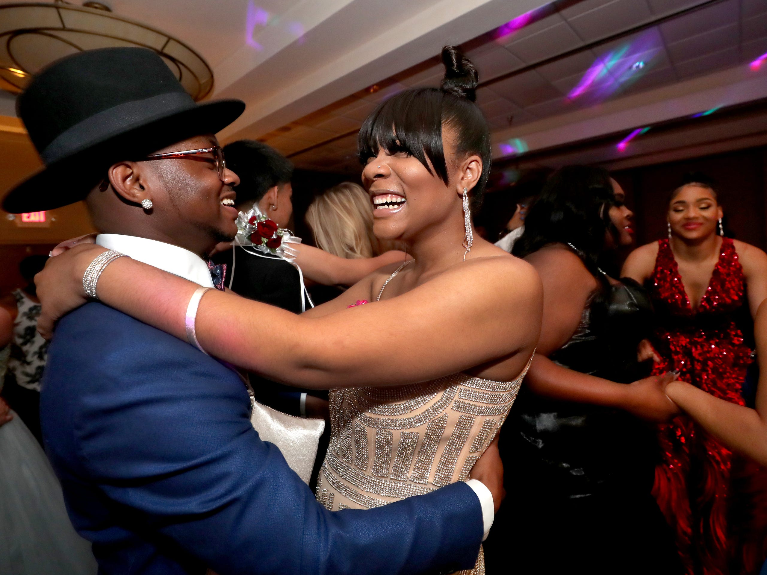 Ahmir Gray, left, and Kennedy Doss, right, dance on the dance floor during Holloway's prom at the DoubleTree on Thursday April 18, 2019.