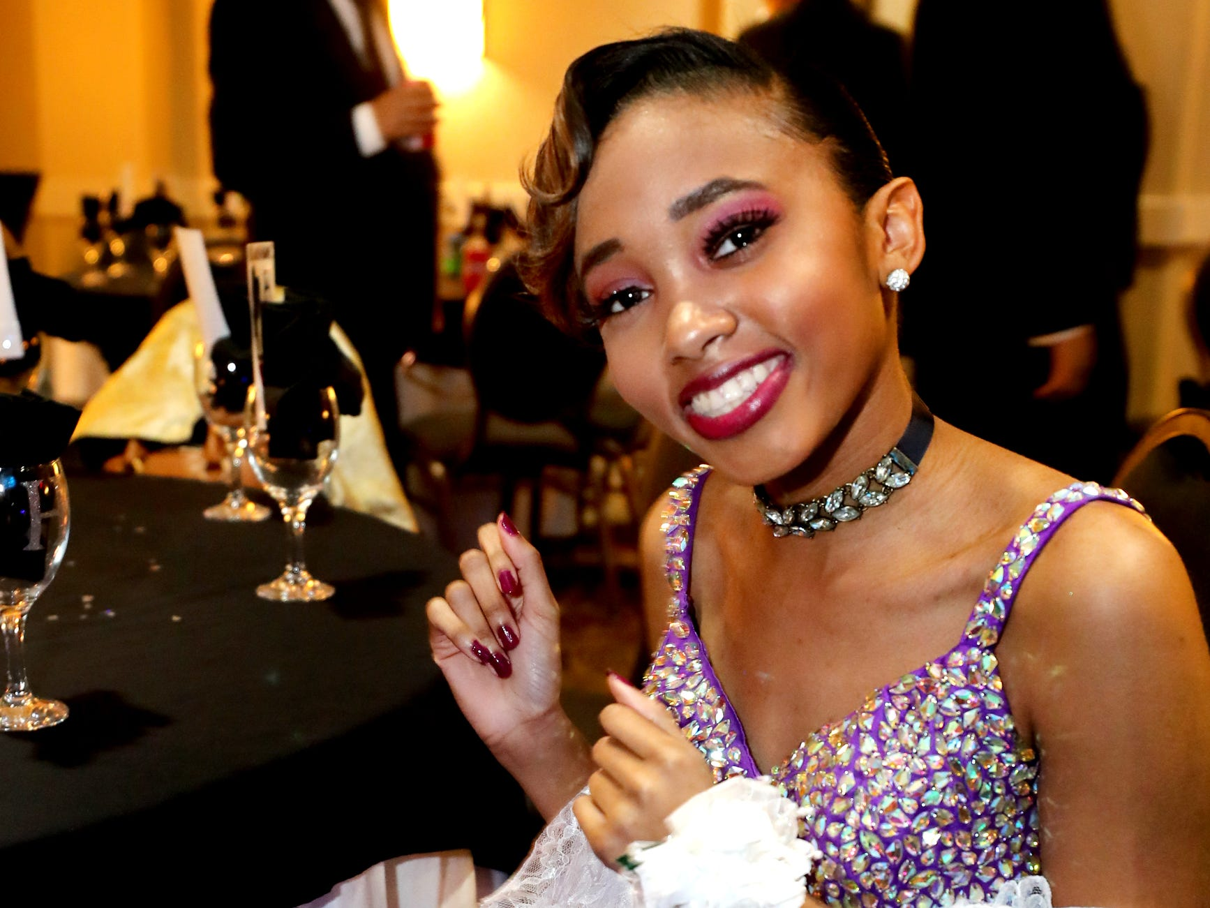Tiara Lewis dances in her seat at Holloway's prom at the DoubleTree on Thursday April 18, 2019.