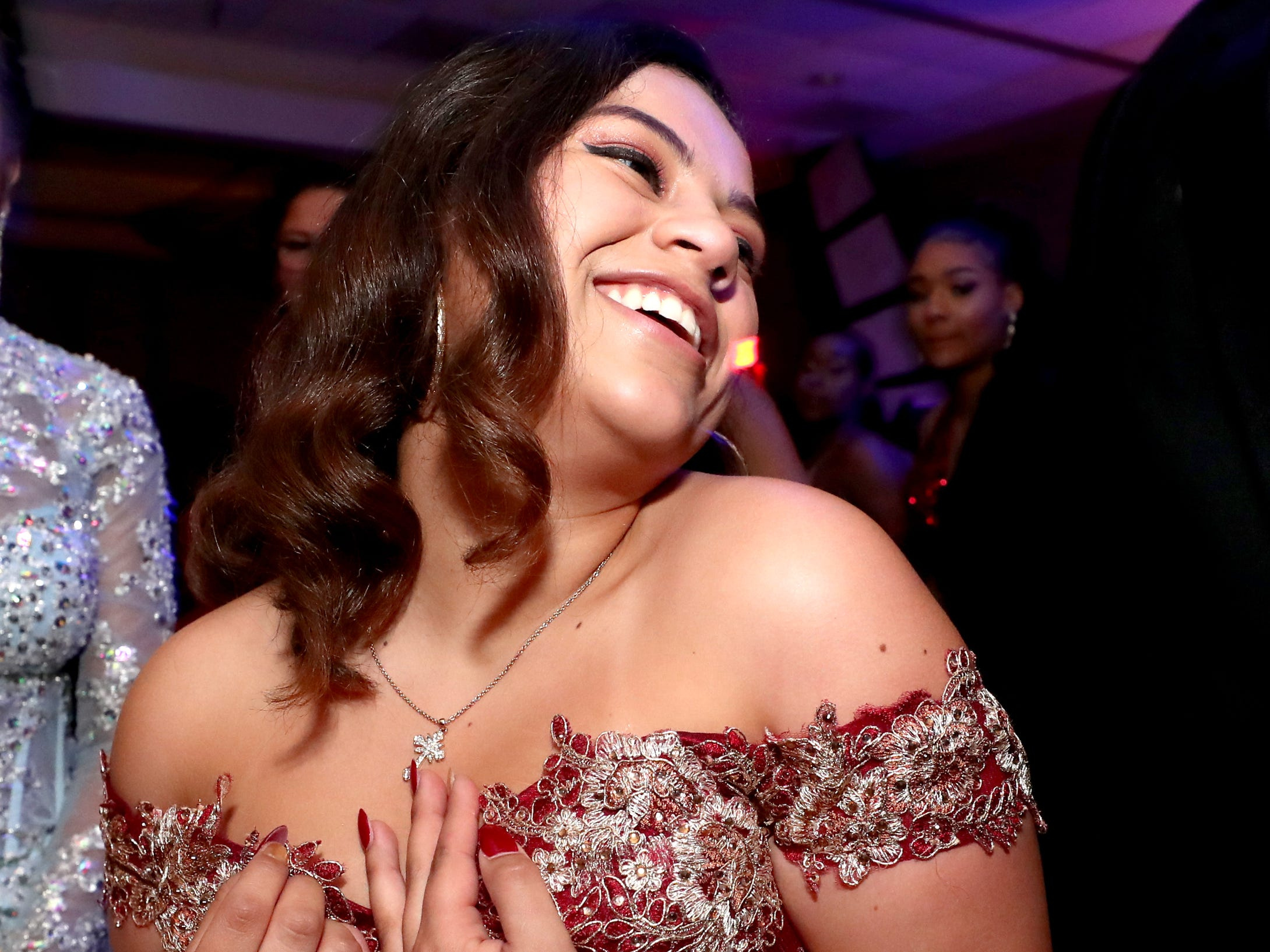 Elizabeth Perez dances on the dance floor at Holloway's prom at the DoubleTree on Thursday April 18, 2019.