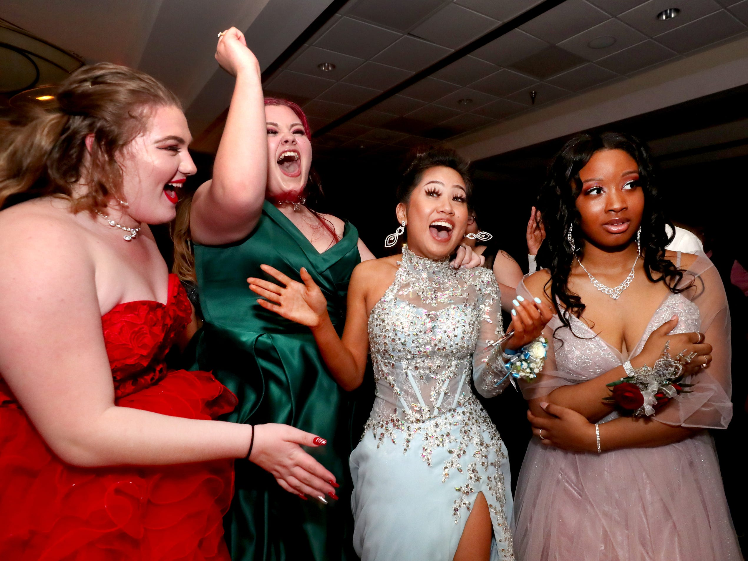 (L to R) Cortney Springer, Evie Douglas, Anna Kounboribounsak and Antoinette Sherrell react as Anna Kounboribounsak is announced as Holloway High's Prom Queen at Holloway's prom at the DoubleTree on Thursday April 18, 2019.
